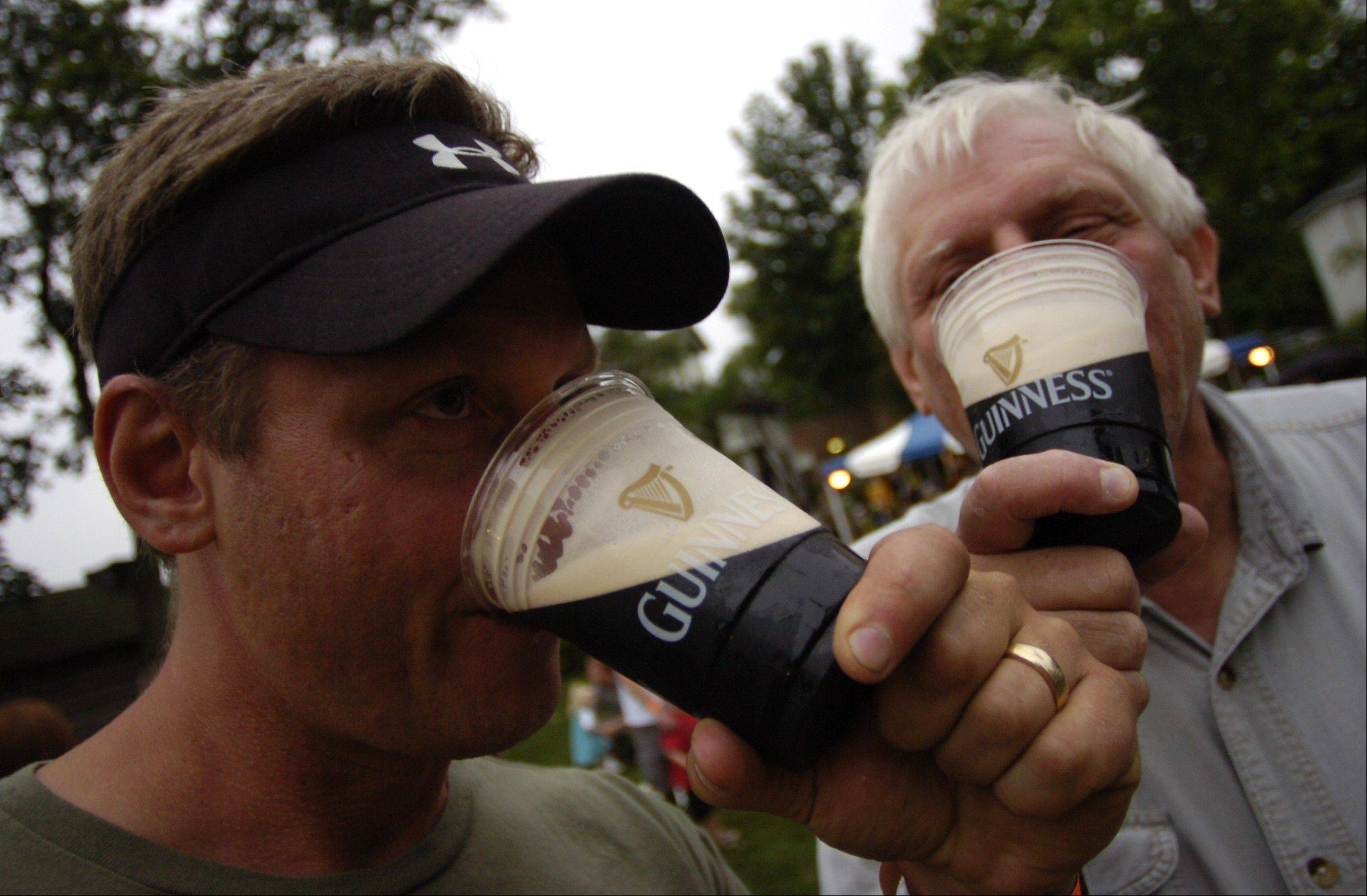 A couple of festival goers partake of the brew.