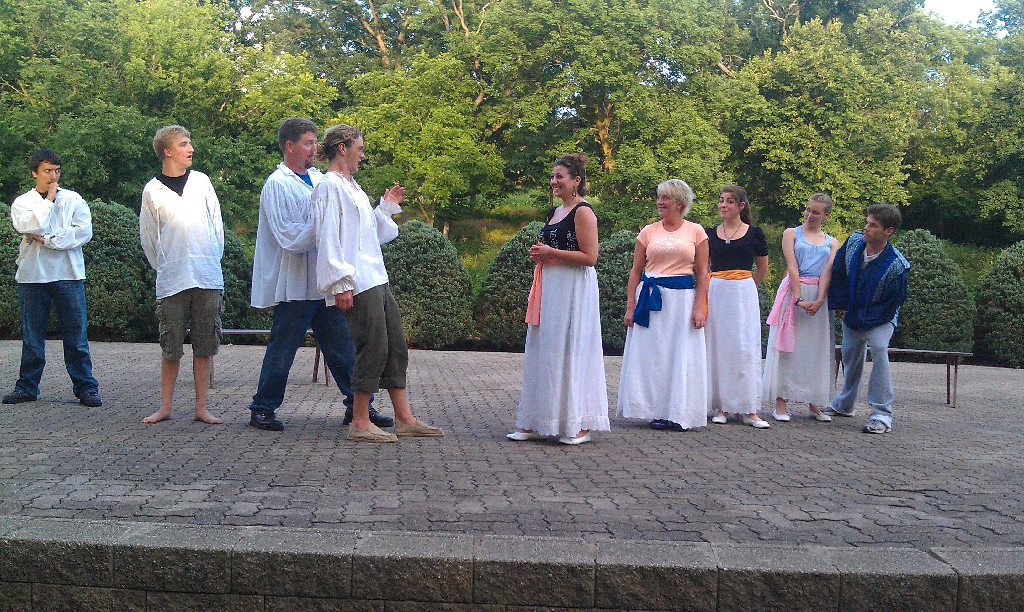 "From left, actors Johnny Schueneman, Doug Burrichter, Dan McQuaid, Robb Cleave, Nicolette Pollack, Kristen Duerdoth, Jessica McCluskey, Allison Grischow, Frank Warpeha rehearse for ""Love's Labour's Lost,"" which will be performed outdoors at 6 p.m. Saturday, July 16 in Geneva's Island Park."