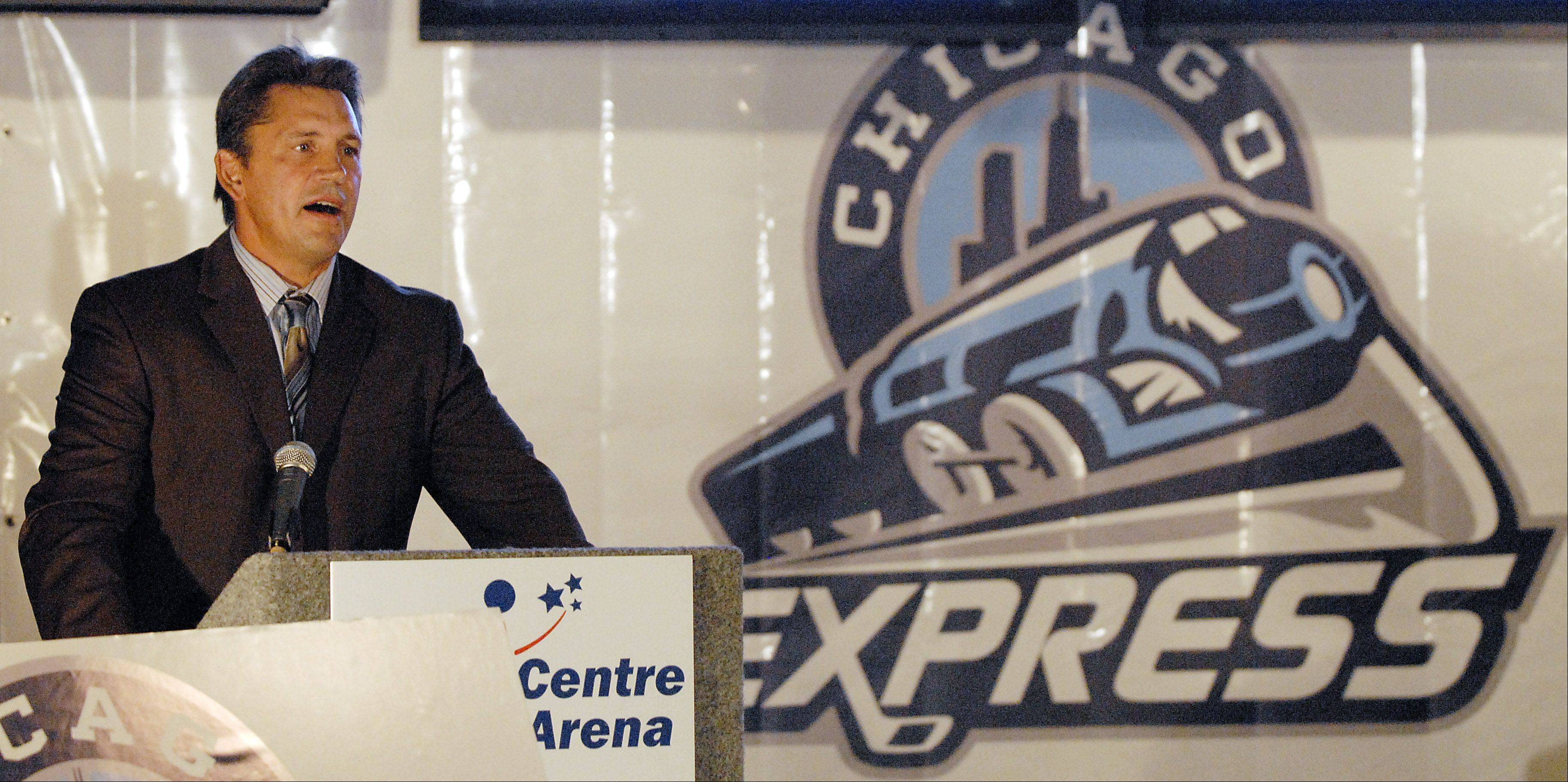 Head Coach Steve Martinson stands next to the team logo as the Chicago Express name is unveiled at a news conference in October 2010 at the Sears Centre in Hoffman Estates.