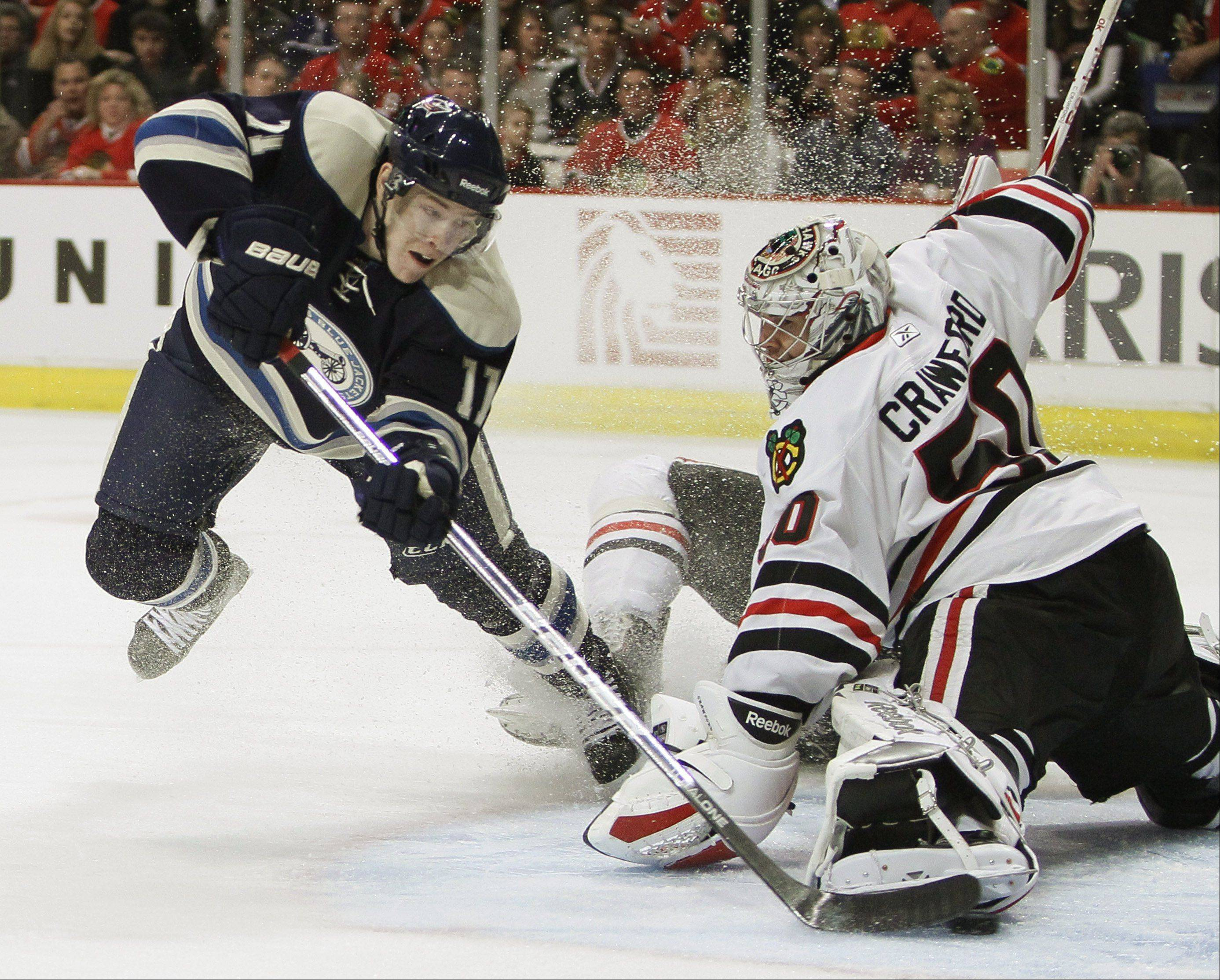 Columbus Blue Jackets winger Matt Calvert scores against Blackhawks goalie Corey Crawford last February. The Blue Jackets will be affiliated with the Chicago Express, which begins play at the Sears Centre in October.