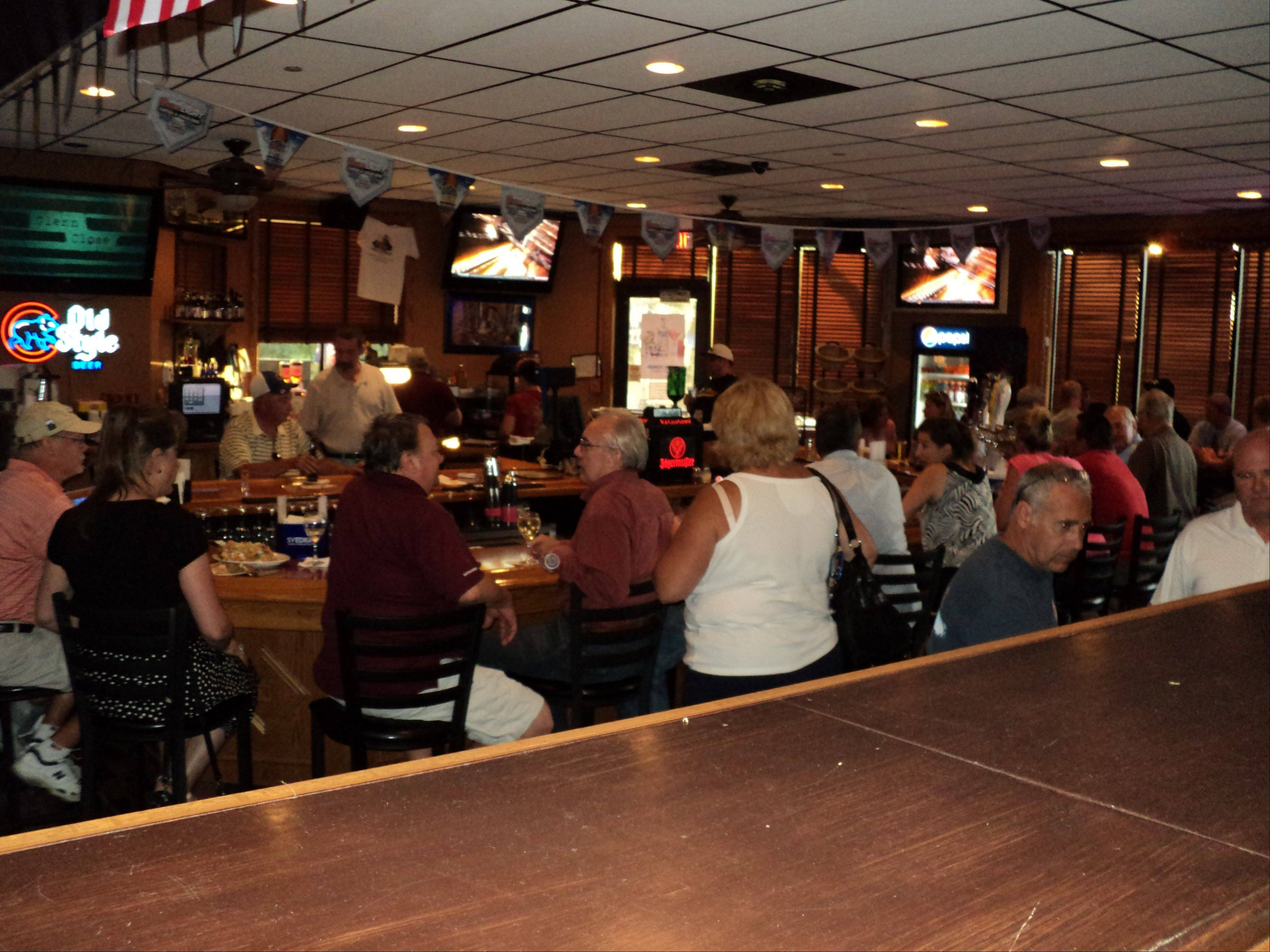 Powerless patrons on Monday packed the Village Bar and Grill in Buffalo Grove to seek an air-conditioned refuge after storms knocked out electricity.