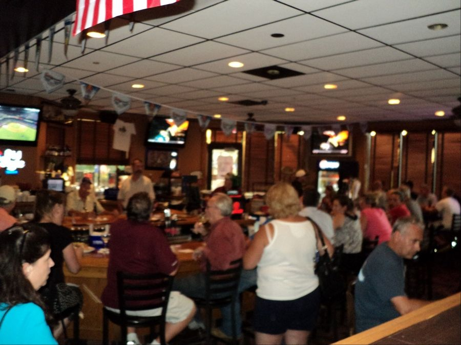 Powerless patrons packed the Village Bar and Grill in Buffalo Grove after storms knocked out electricity for many customers.
