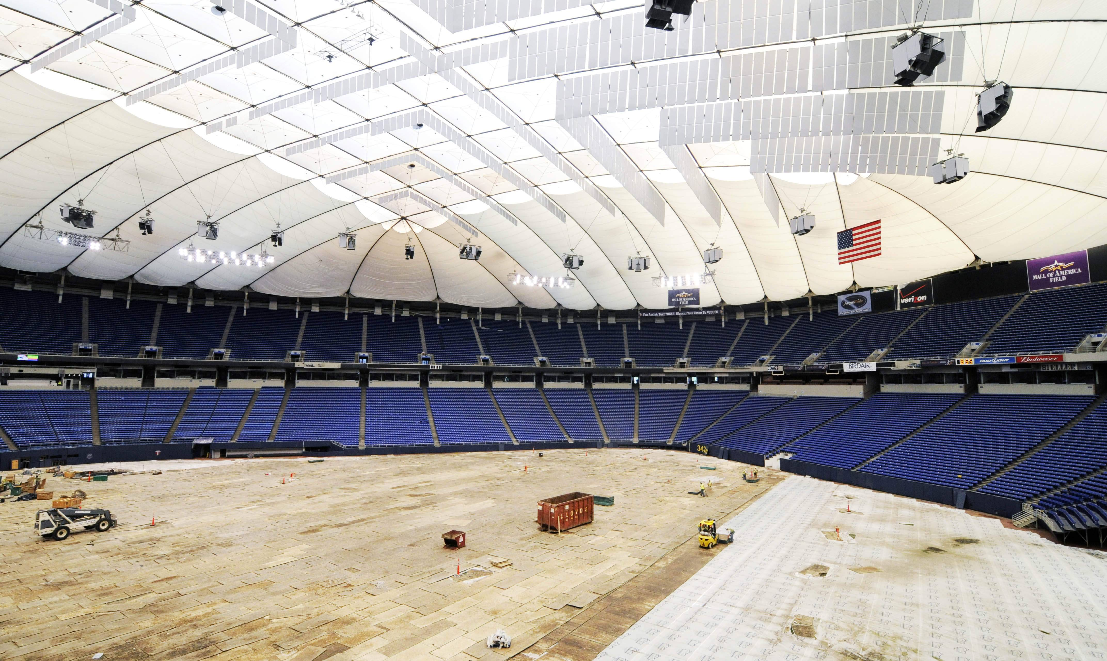 The new roof of the Metrodome, home of the Minnesota Vikings NFL football team, is in place after it was inflated for the first time Wednesday in Minneapolis. The original roof collapsed last December after a snowstorm dumped 17 inches of snow. The hanging grey panels help provide better acoustics.