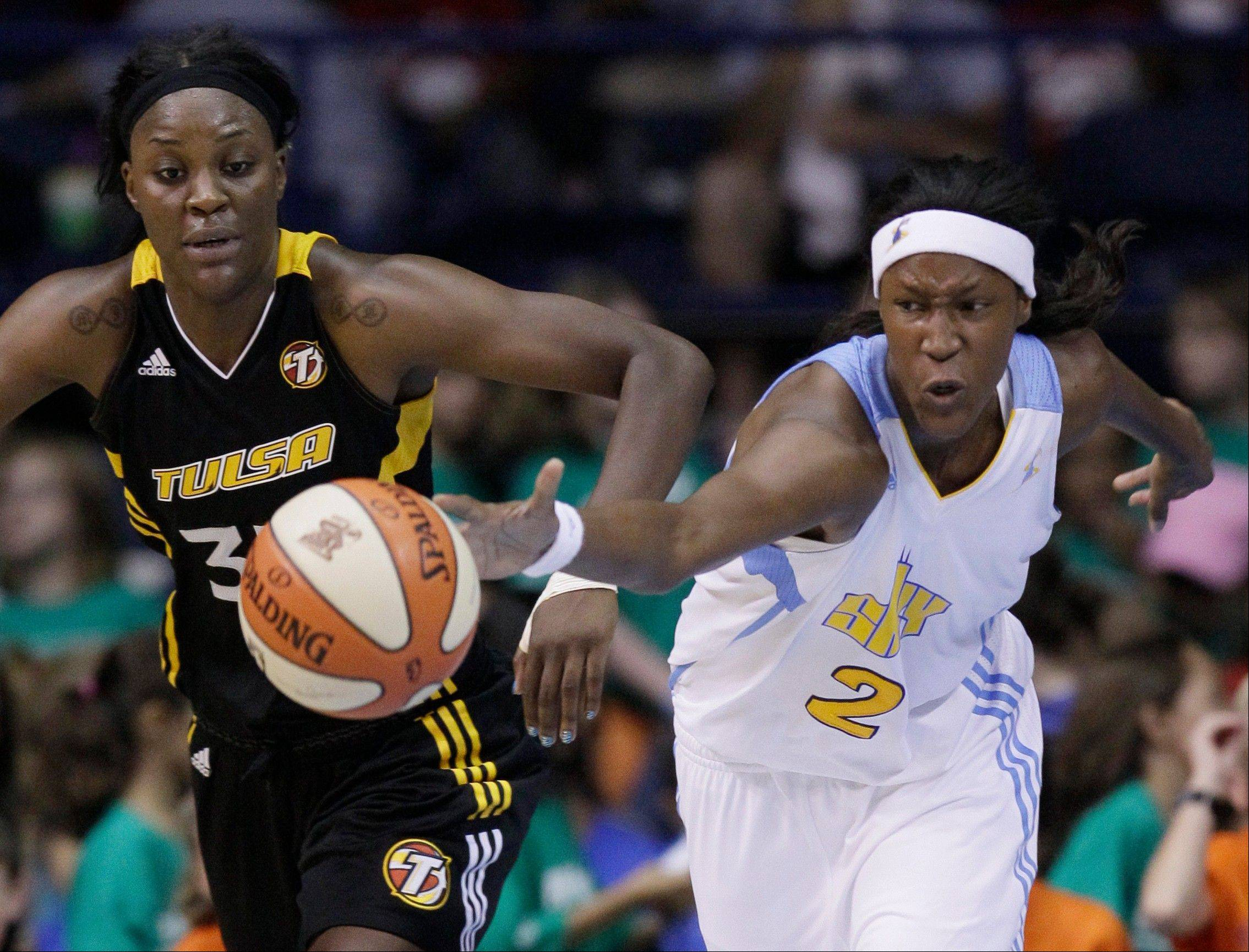 The Chicago Sky's Michelle Snow controls the ball past Tulsa Shock's Tiffany Jackson during the second half of their game Wednesday at the Allstate Arena.