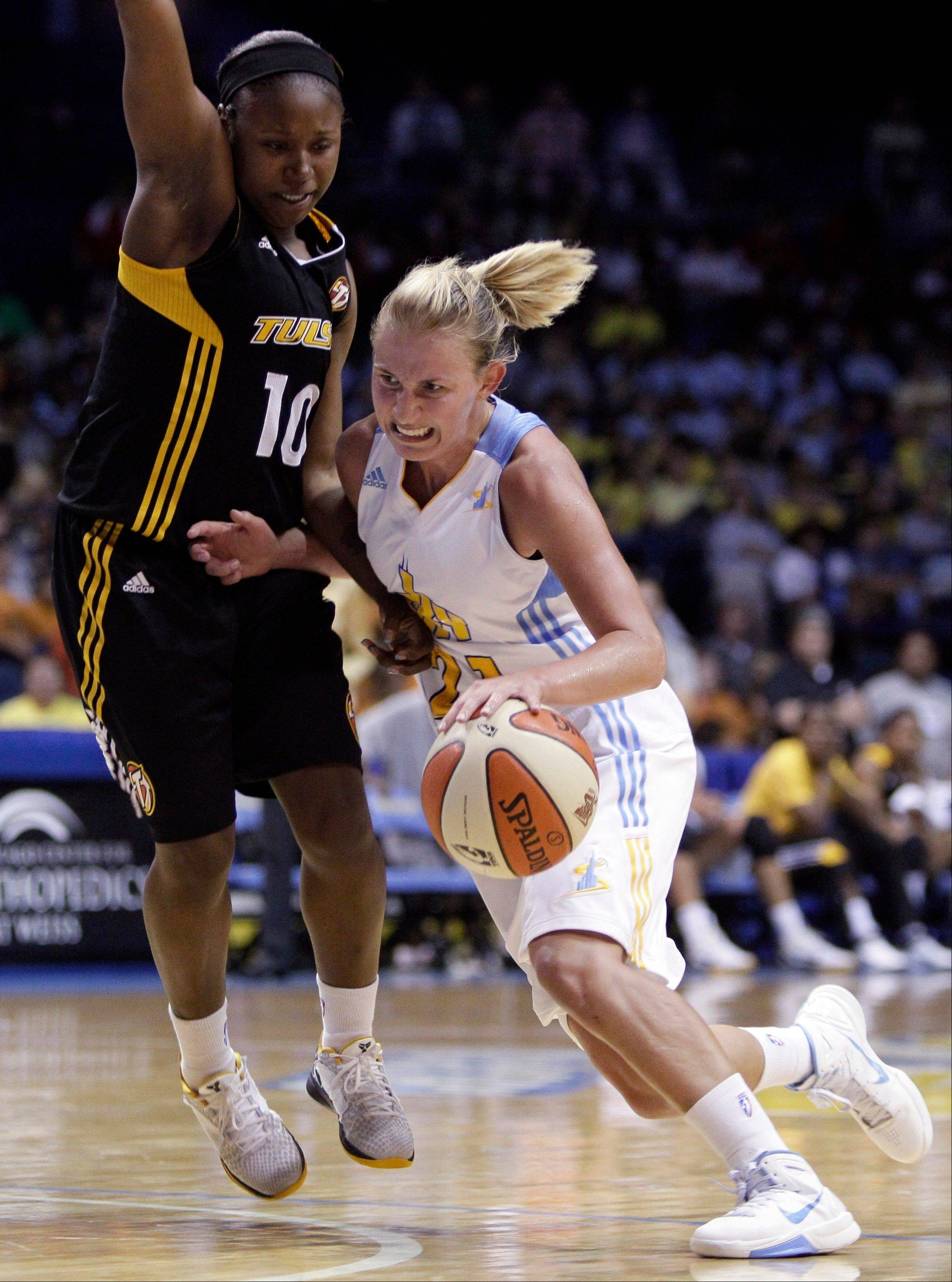 Chicago Sky's Courtney Vandersloot, right, drives to the basket as Tulsa Shock's Andrea Riley guards during the second half of an WNBA basketball game on Wednesday, July 13, 2011, in Rosemont, Ill. The Sky won 72-54.