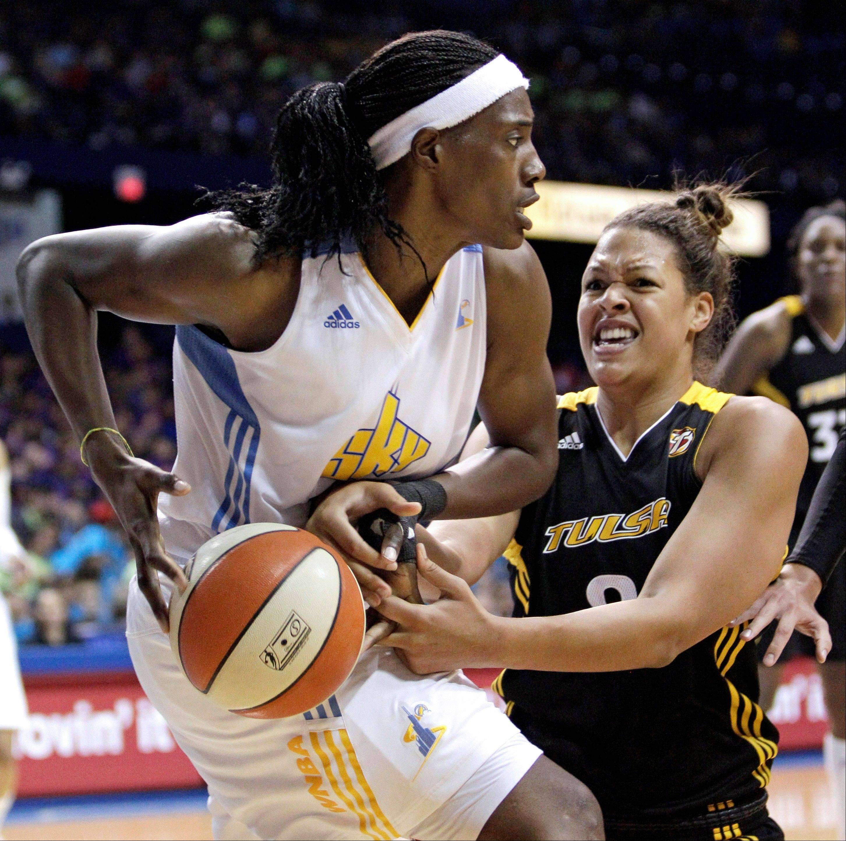Chicago Sky's Sylvia Fowles, left, and Tulsa Shock's Elizabeth Cambage battle for a rebound during the second half of a WNBA basketball game on Wednesday, July 13, 2011, in Rosemont, Ill. The Sky won 72-54.