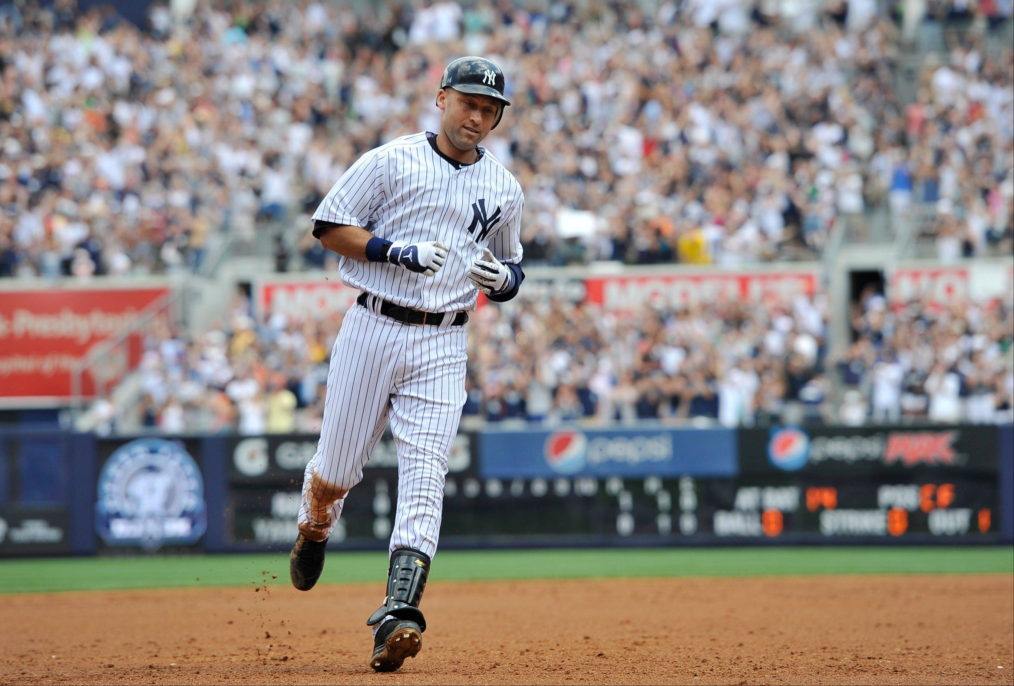 Yankees shortstop Derek Jeter rounds third base after he hit a solo home run, his 3,000th career hit, off Tampa Bay Rays starting pitcher David Price in the third inning Saturday at Yankee Stadium.