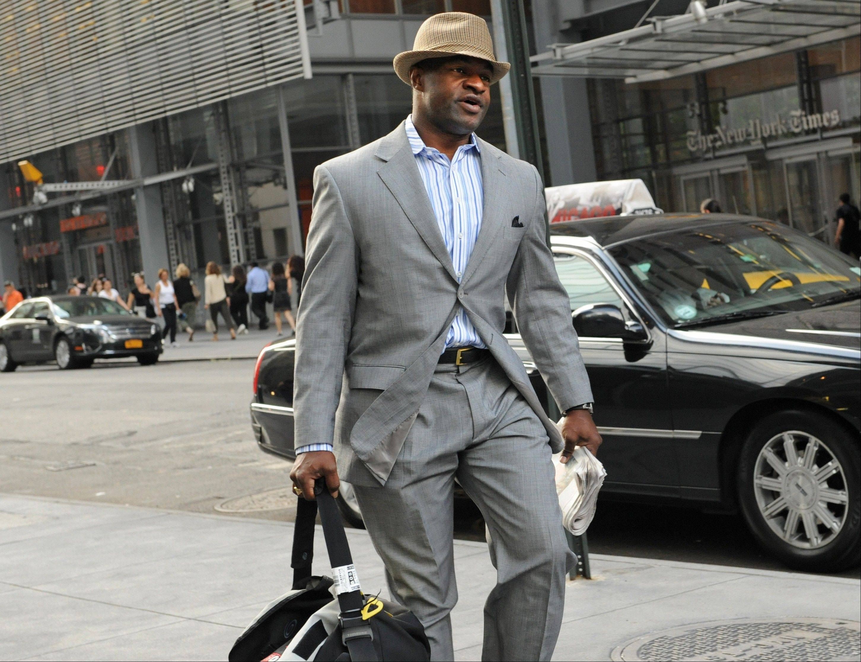 NFL Players Association executive director DeMaurice Smith enters a Manhattan law office Wednesday. NFL owners and player representatives arrived for another round of labor talks as the negotiations hit a critical phase.