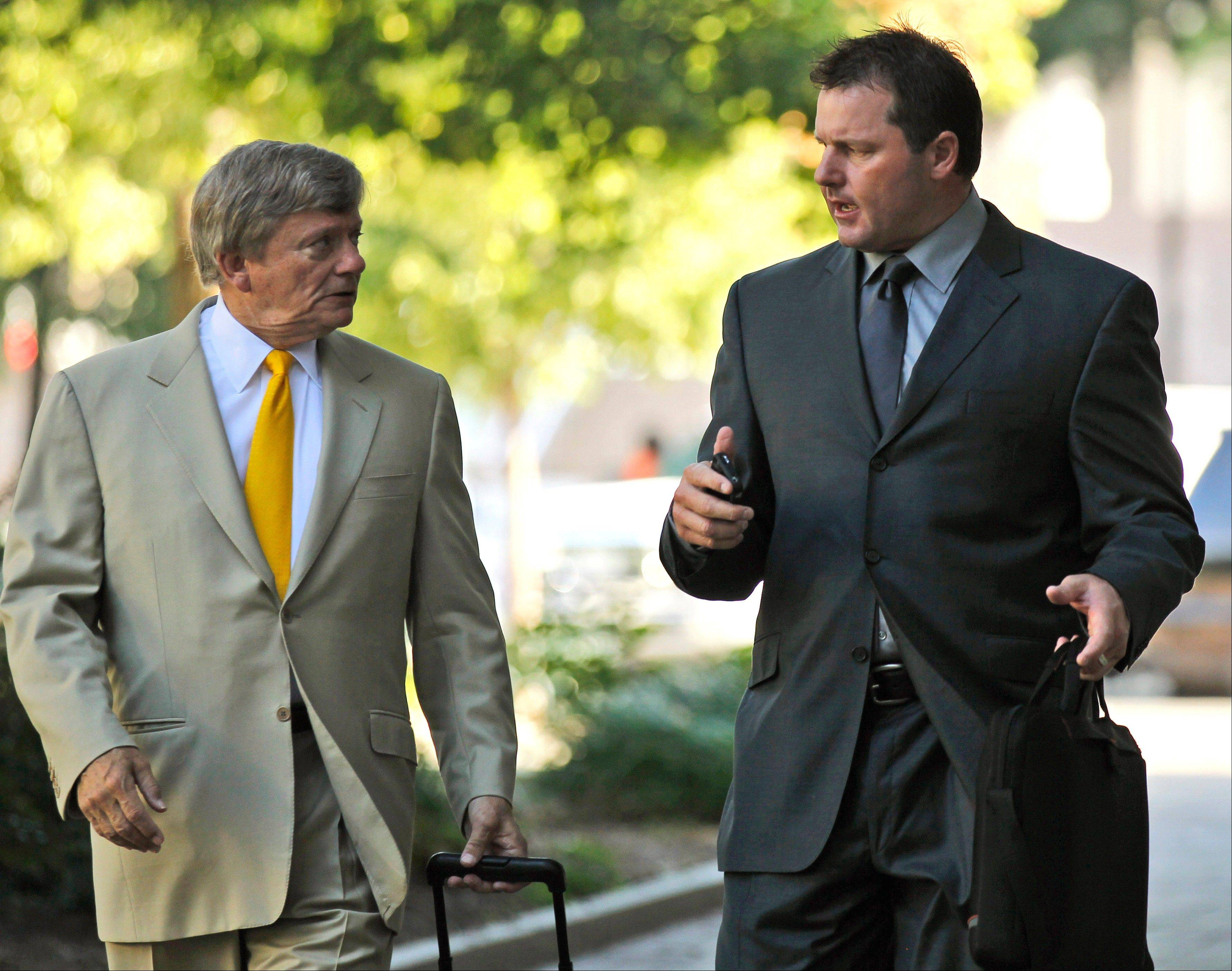 Former Major League Baseball pitcher Roger Clemens, right, and his attorney Rusty Hardin, arrive at federal court in Washington Wednesday for his perjury trial. The newly seated jury of 10 women and two men is scheduled to get to work Wednesday with opening arguments.