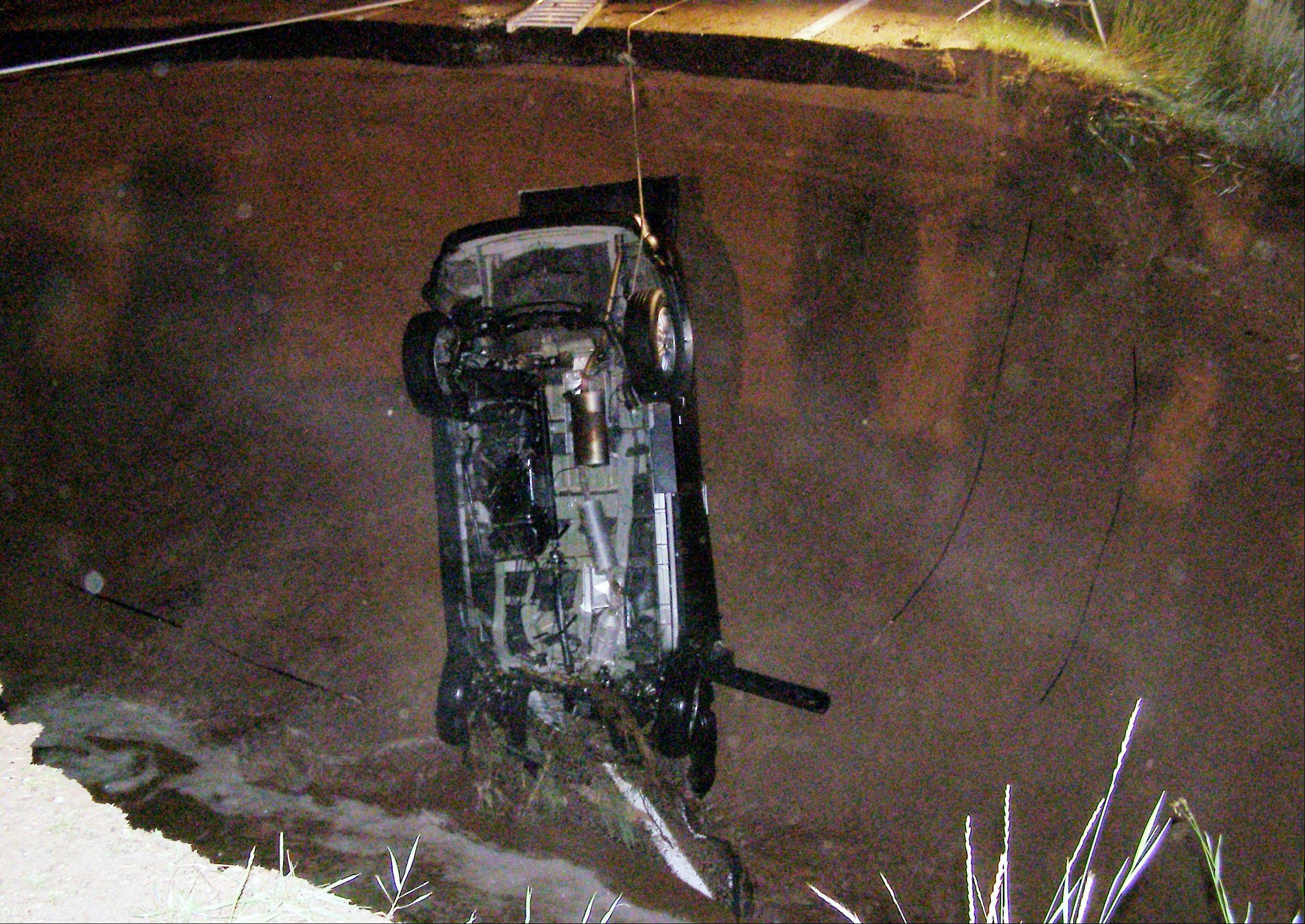 A teenage girl is dead and her father seriously injured after this SUV plunged into a hole in the highway near Tabiona, Utah, early Thursday.