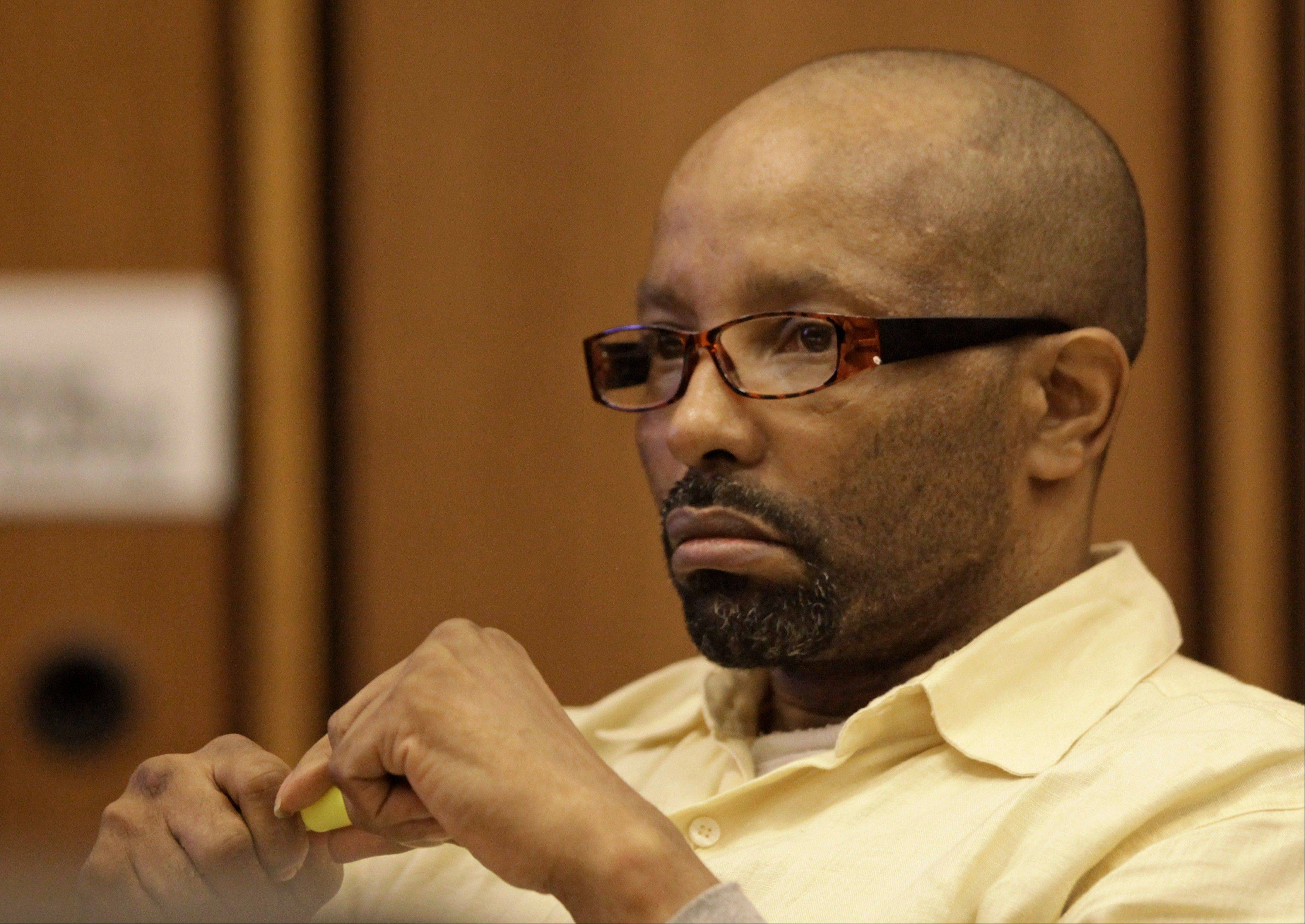 Anthony Sowell listens to testimony during his trial Thursday in Cleveland.