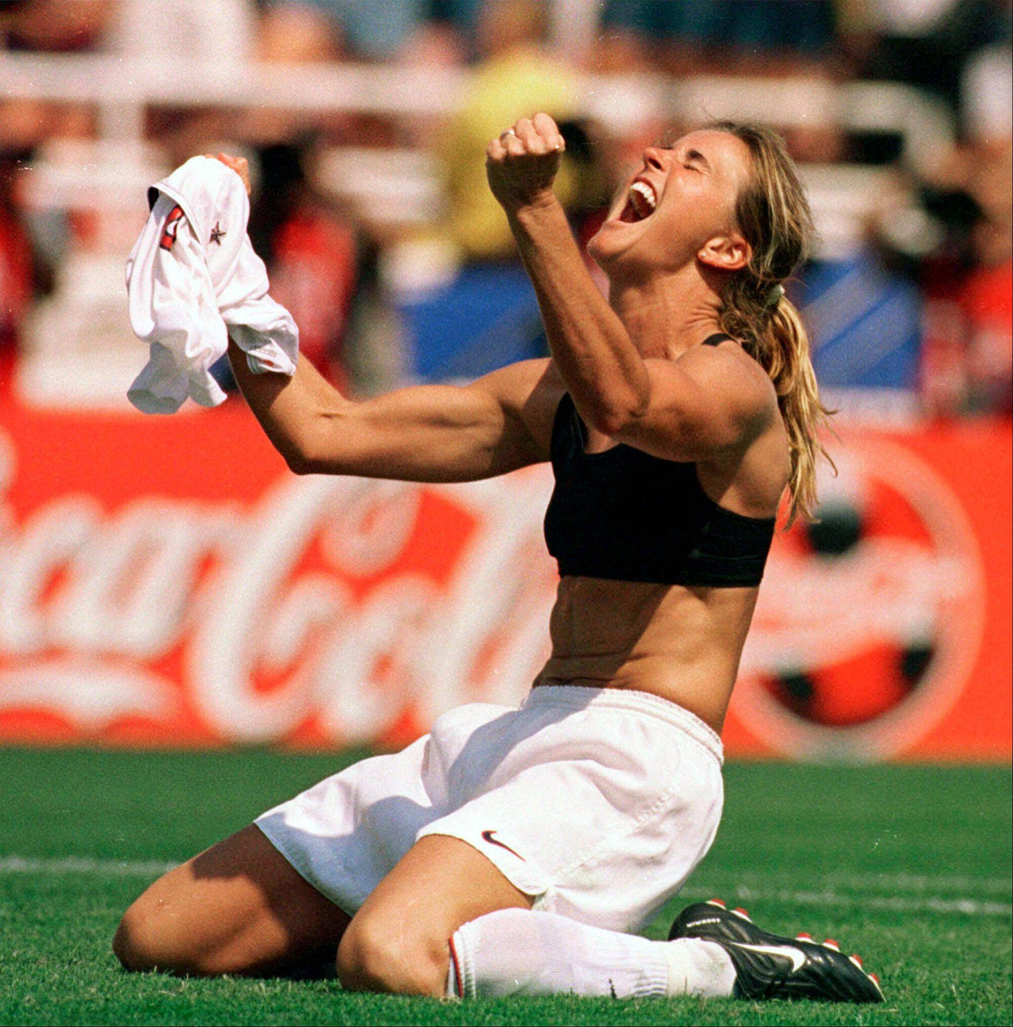 The United States' Brandi Chastain celebrates by taking off her jersey after kicking in the game-winning penalty shootout goal against China in the 1999 Women's World Cup Final at the Rose Bowl in Pasadena, Calif. Tony DiCicco sees more than a few similarities to his 1999 team, the last group of Americans to win the World Cup: heart, desire, the refusal to give up.