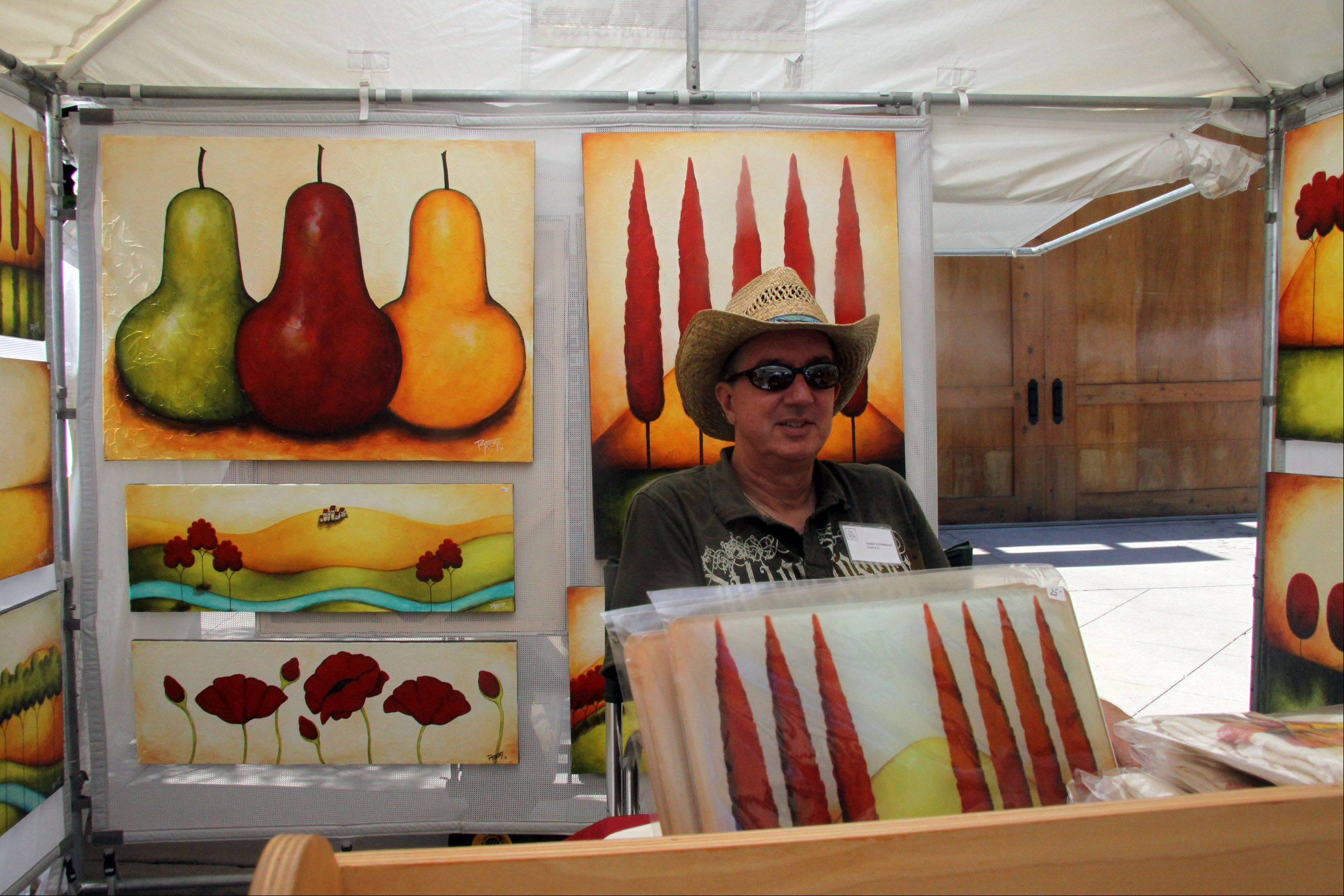 The Art at the Shops festival returns to Yorktown Center in Lombard this weekend with 50 juried artists from all over the country. Robert Rodenberger of Marietta, Ga., was among those who exhibited last year.