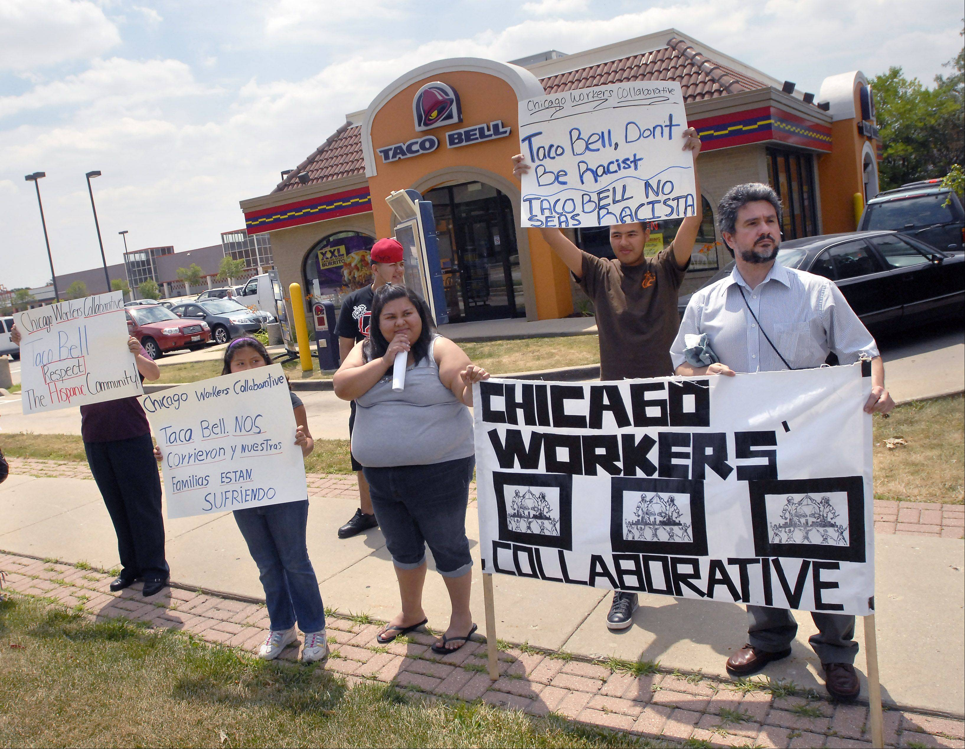 Members of the Chicago Workers' Collaborative stage a protest Thursday in front of the Taco Bell restaurant on Kirchoff Road in Rolling Meadows. They allege that several workers, some working there for over 10 years, were unfairly fired.