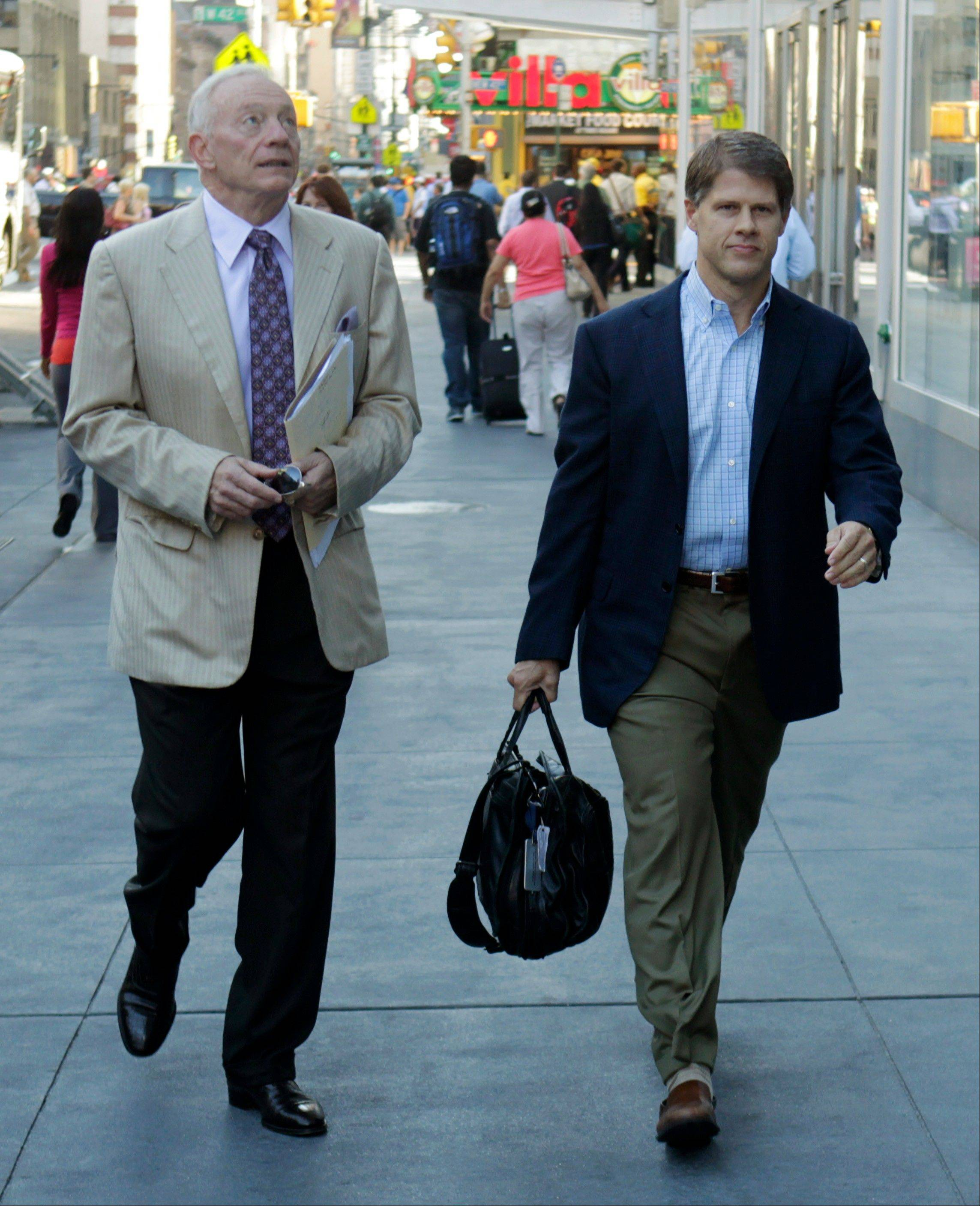 Dallas Cowboys owner Jerry Jones, left, and Kansas City Chiefs owner Clark Hunt arrives at a Manhattan law firm Thursday. With time running short to keep the NFL's preseason completely intact, owners and player representatives are back in force, trying again to work out a new labor deal.