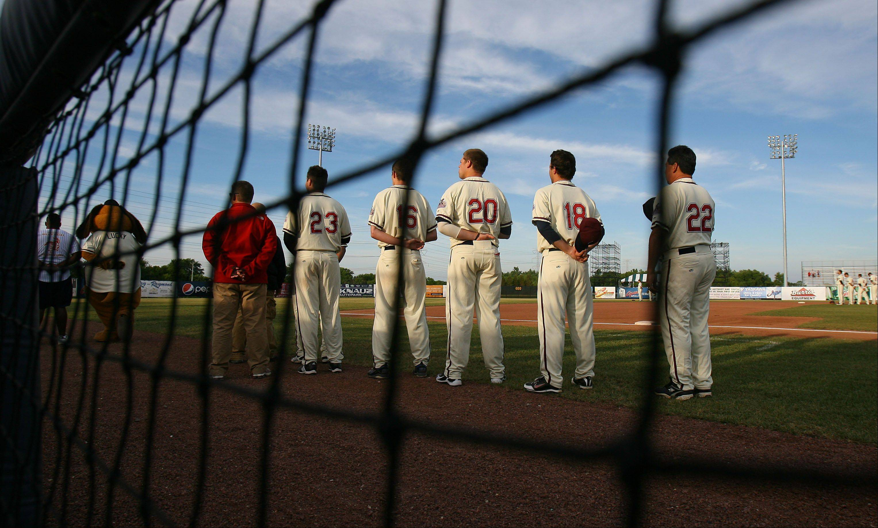 Fielders players line up during the national anthem during their game against the Chico Outlaws Wednesday night in Zion.