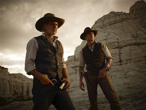 "Harrison Ford, left, and Daniel Craig in ""Cowboys & Aliens."" which will be showcased at this years Comic-Con"
