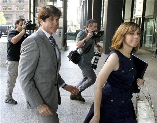 Former Illinois Gov. Rod Blagojevich, left, and his wife, Patti, arrive at the federal courthouse for a hearing in Chicago, Friday.