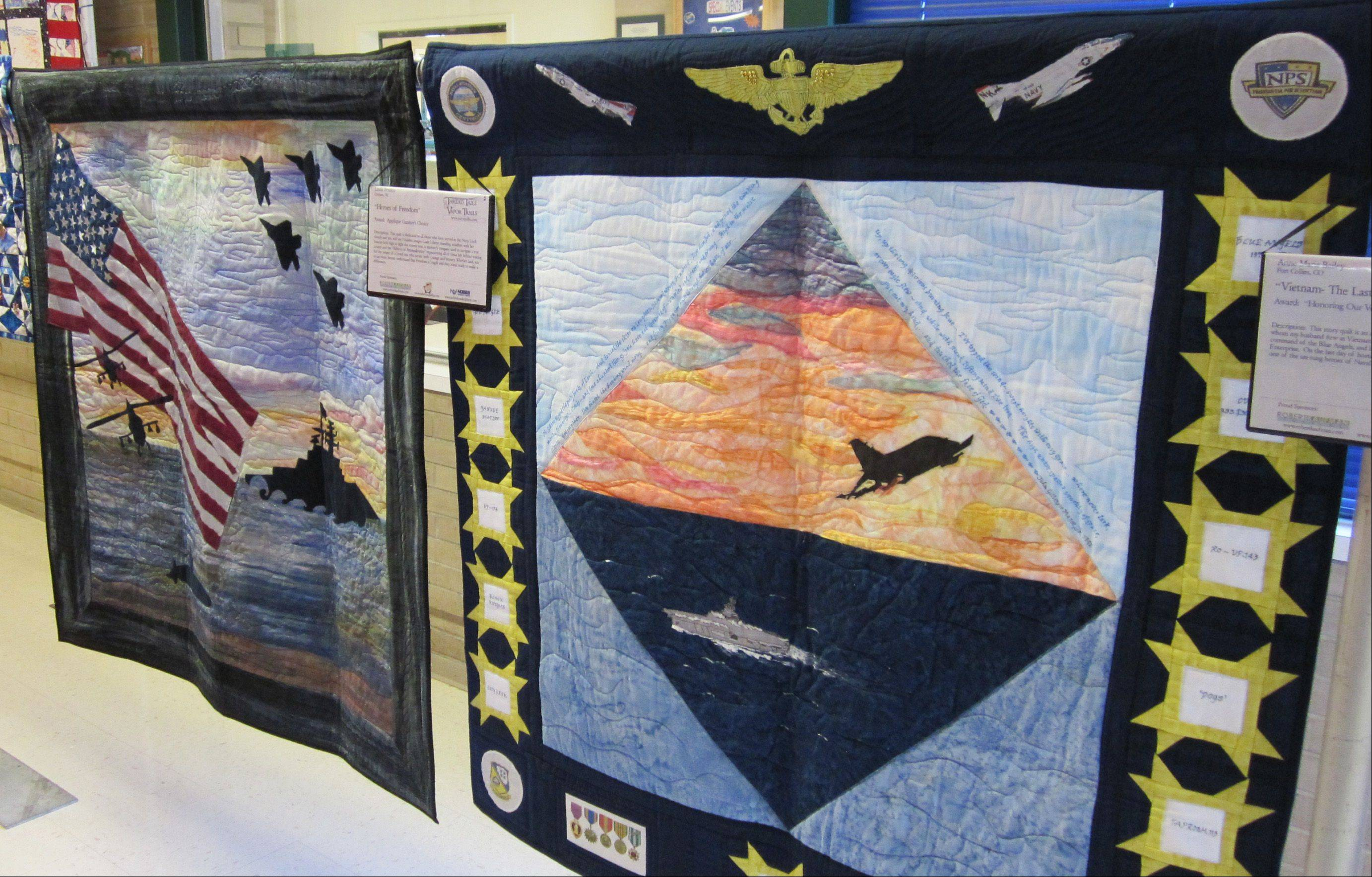 "These two quilts are just a small sample of the many that will be on display this weekend at the ""Threads From Past to Present"" quilt show in Batavia. At left is ""Heroes of Freedom"" by Linda Braden of Alabama, dedicated to all those who have served in the Navy. At right is ""Vietnam — The Last POW,"" by Anne Marie Bailey of Colorado. It is a visual account of Harley H. Hall, a Naval aviator who flew with Bailey's husband during the Vietnam War."