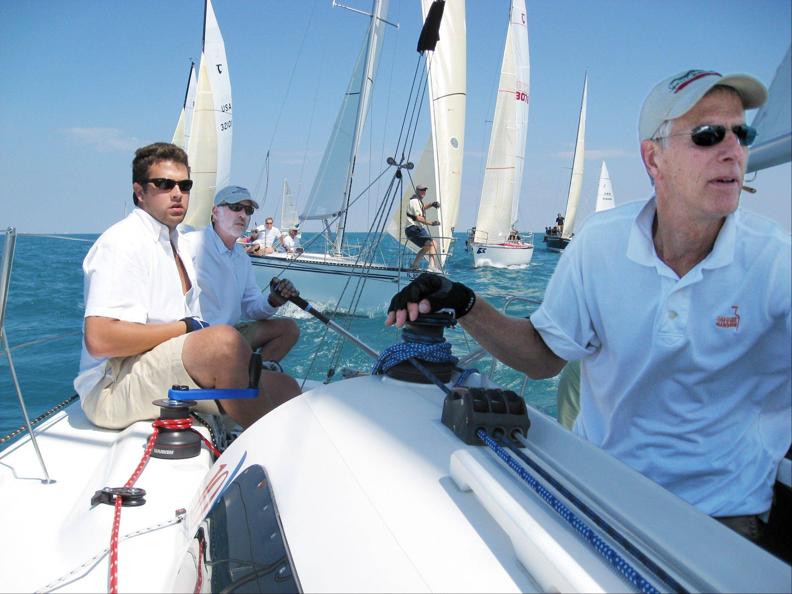 From left, Chris McNicholas, David Finlay and Tom Verhey sail the Jing Bang.