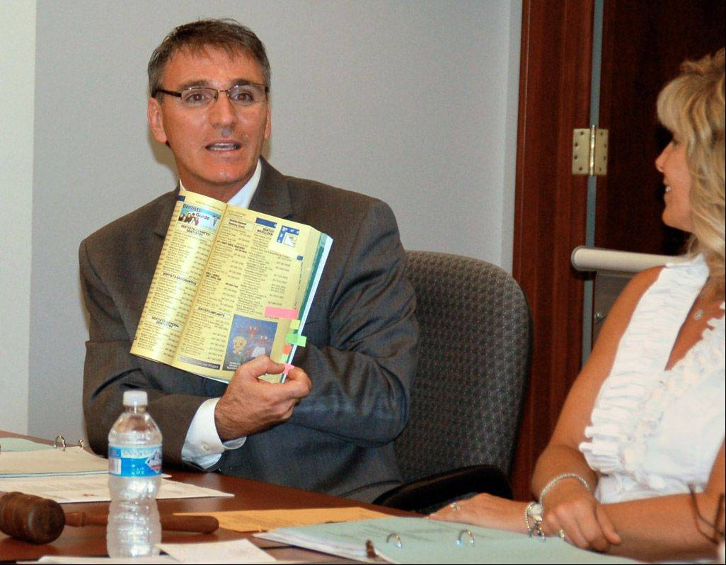 Libertyville District 70 Superintendent Guy Schumacher recently showed a First Choice phone book with student artwork to the school board.