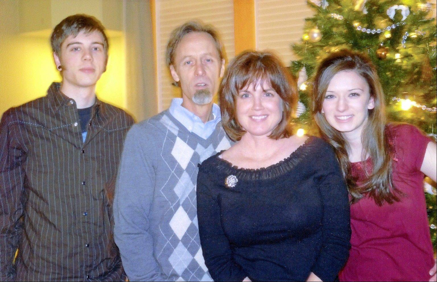 Wally Preissing, second from left, pictured with his family, from left, son, Jack, 21, wife, Theresa, and daughter, Eva, 19. Family members are hosting a benefit Saturday in Arlington Heights for Preissing, who's battling emphysema and needs a lung transplant.