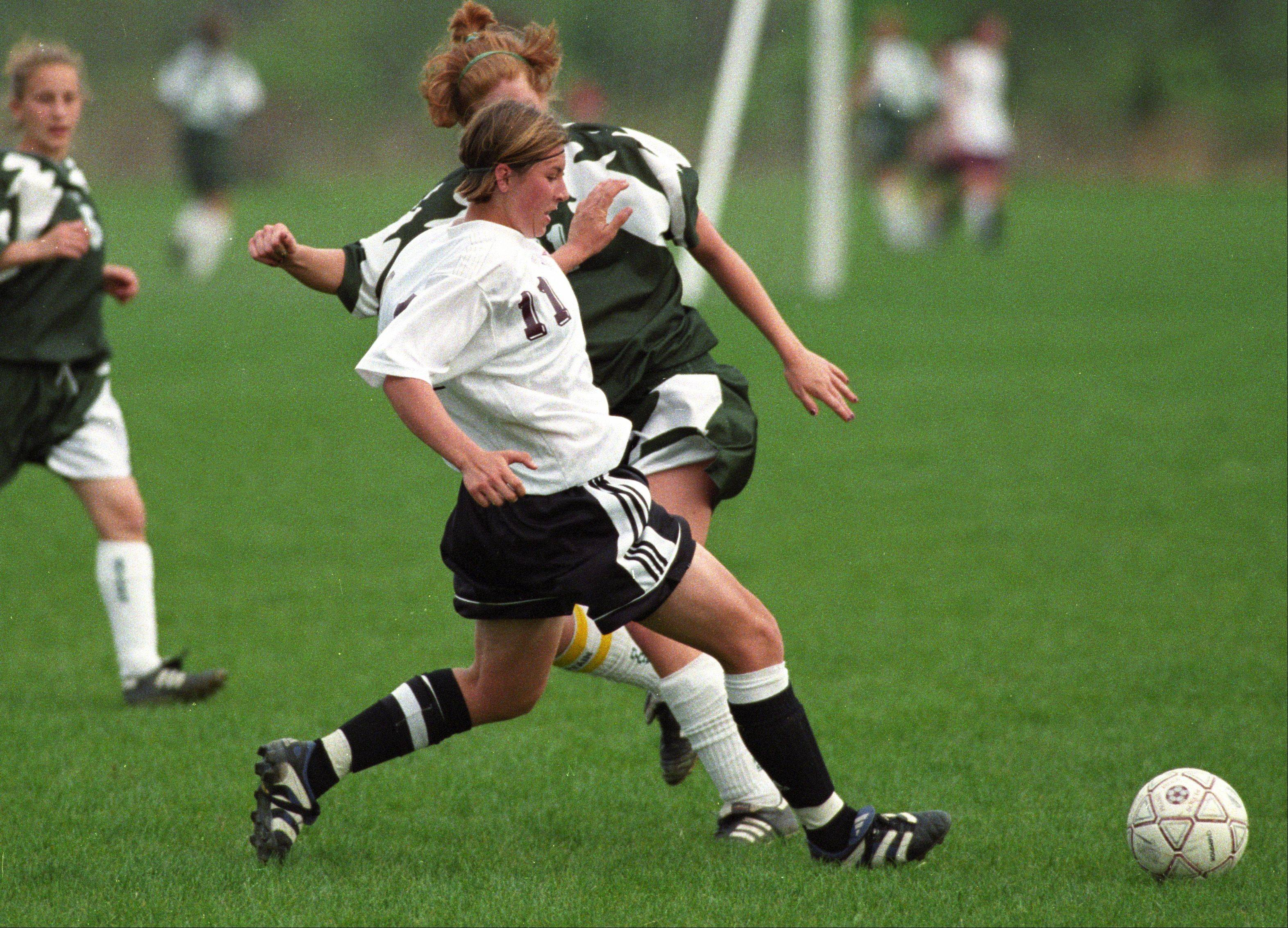 Prairie Ridge soccer standout Amy LePeilbet (11) plays during a match against Crystal Lake South in 1999. LePeilbet, of Crystal Lake, is now a defender on the U.S. Women's Soccer Team.
