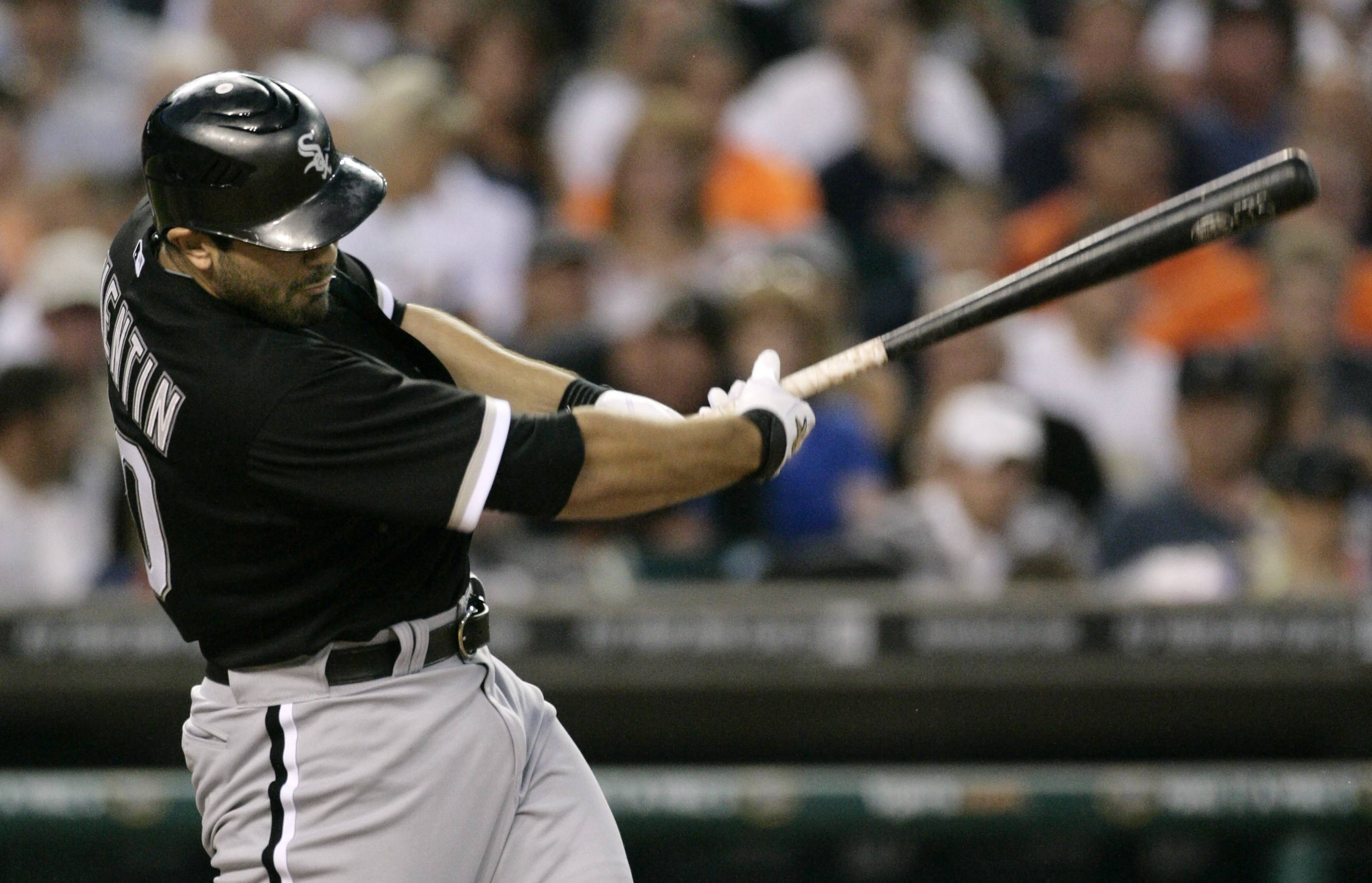 Carlos Quentin singles in the seventh inning Friday to drive in Paul Konerko against the Detroit Tigers.