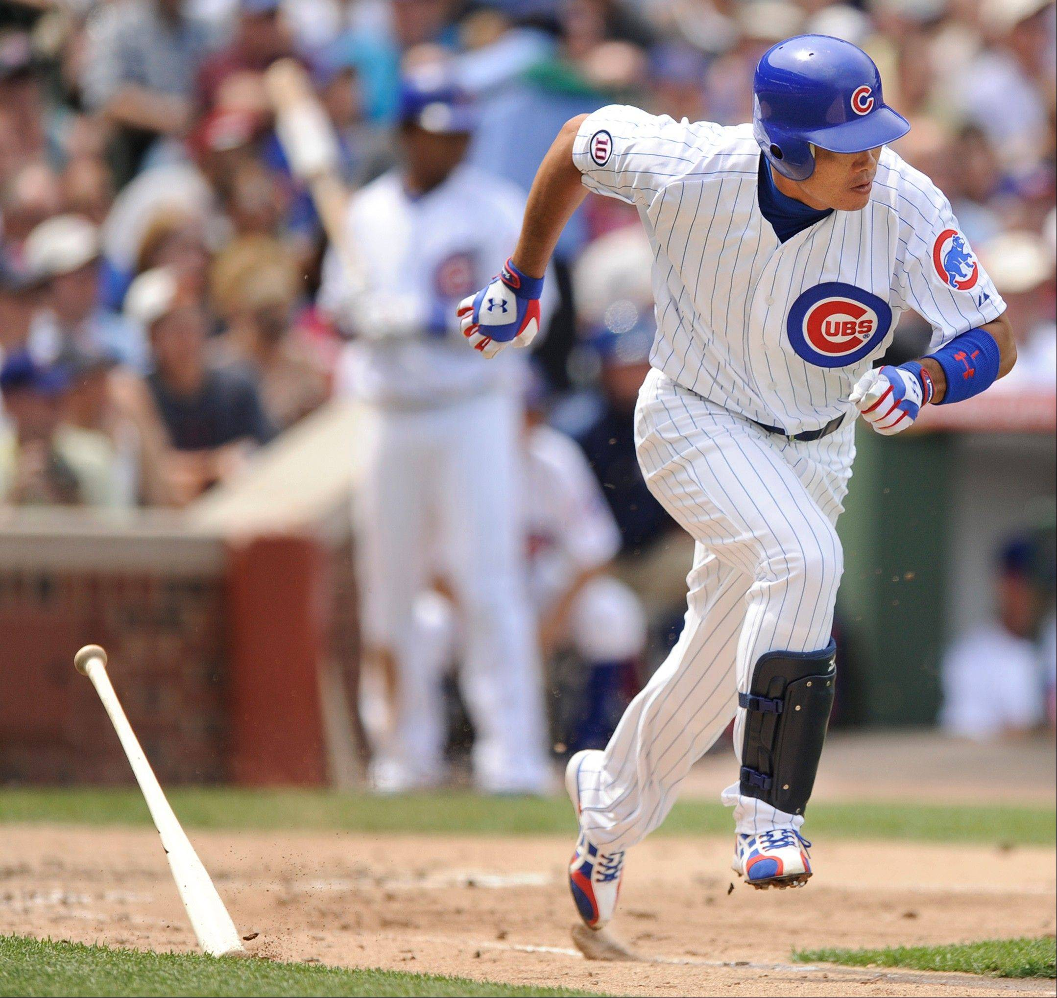 Kosuke Fukudome runs to first base after hitting a single against the Florida Marlins in the third inning on Friday.