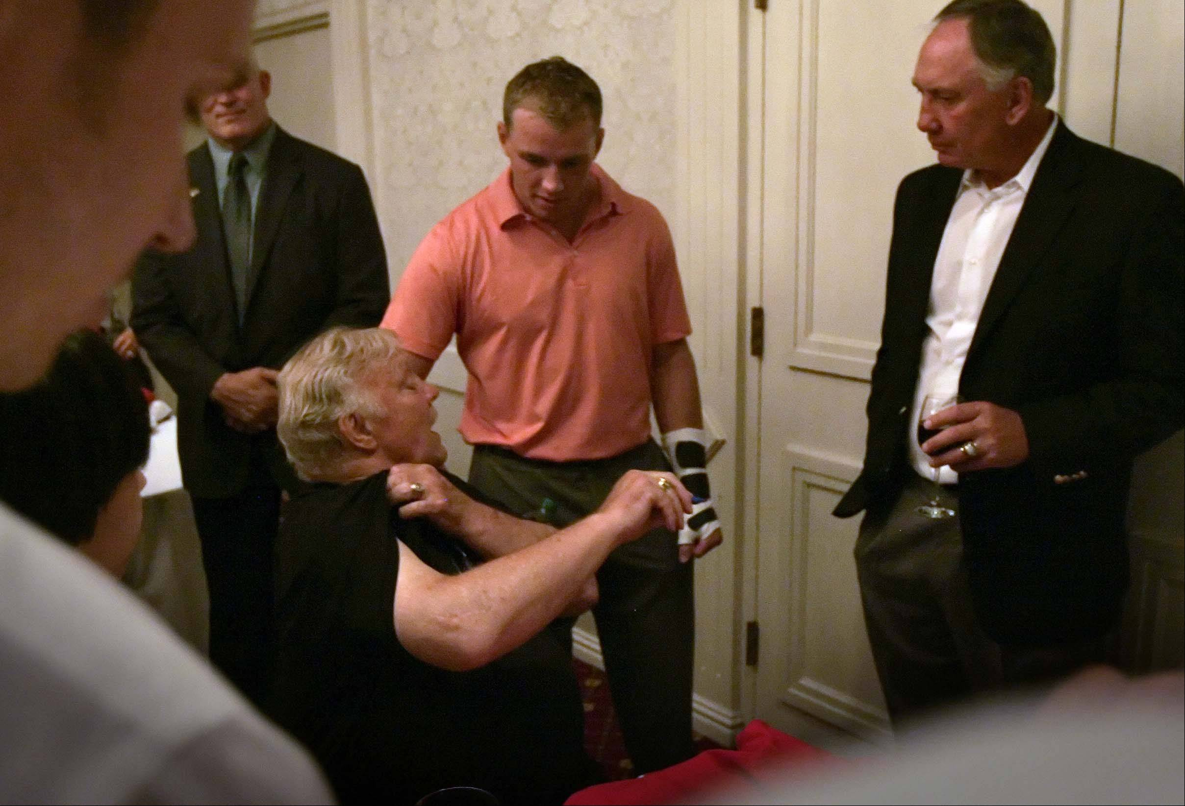 Blackhawks legend Bobby Hull, seated, chats with Patrick Kane about injuries Friday during the Blackhawks fan convention. Kane is sporting a cast on his left wrist and will undergo surgery to repair a scaphoid fracture.