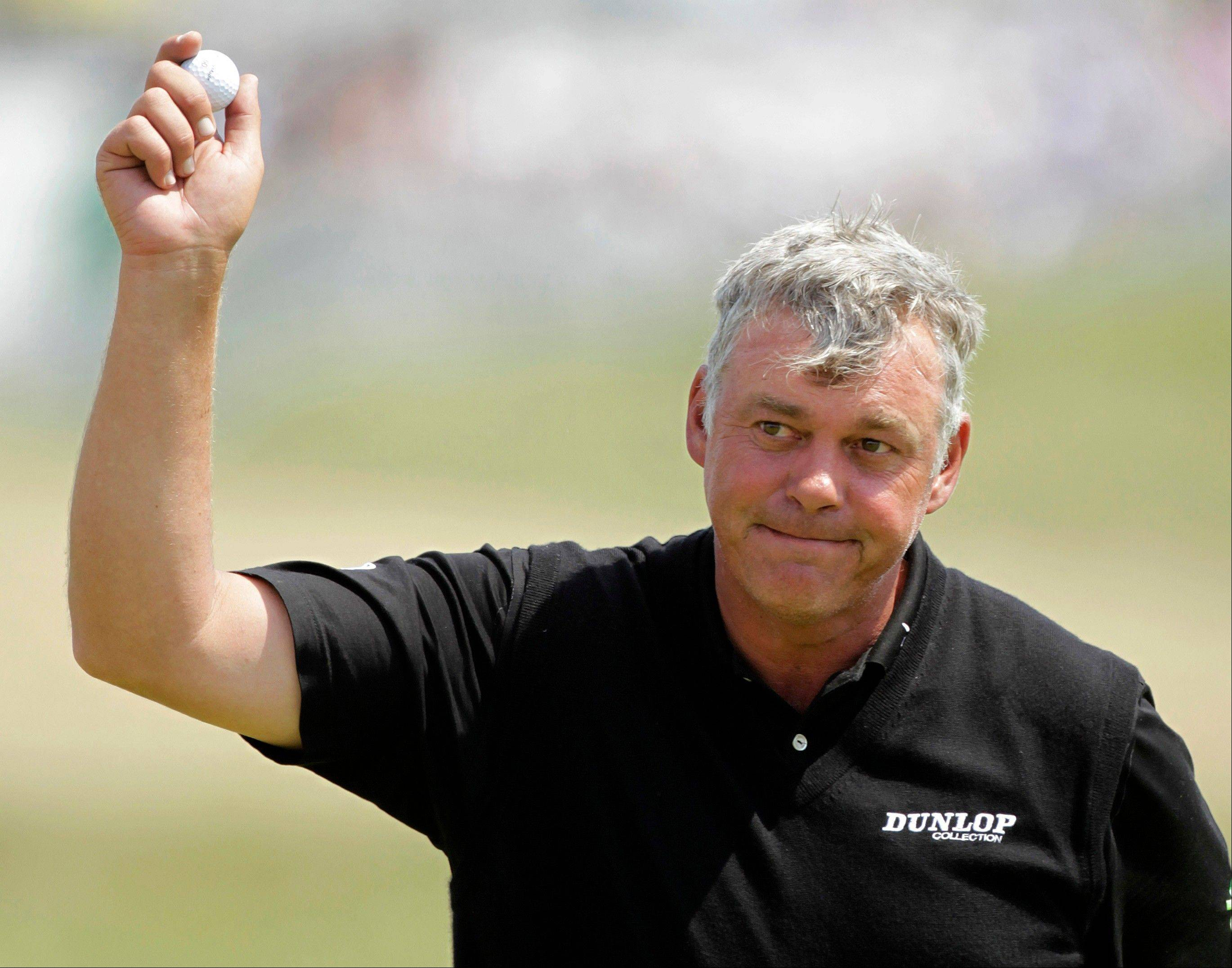 Northern Ireland's Darren Clarke reacts Friday after putting on the 18th green during the second day of the British Open Golf Championship at Royal St George's golf course Sandwich, England.