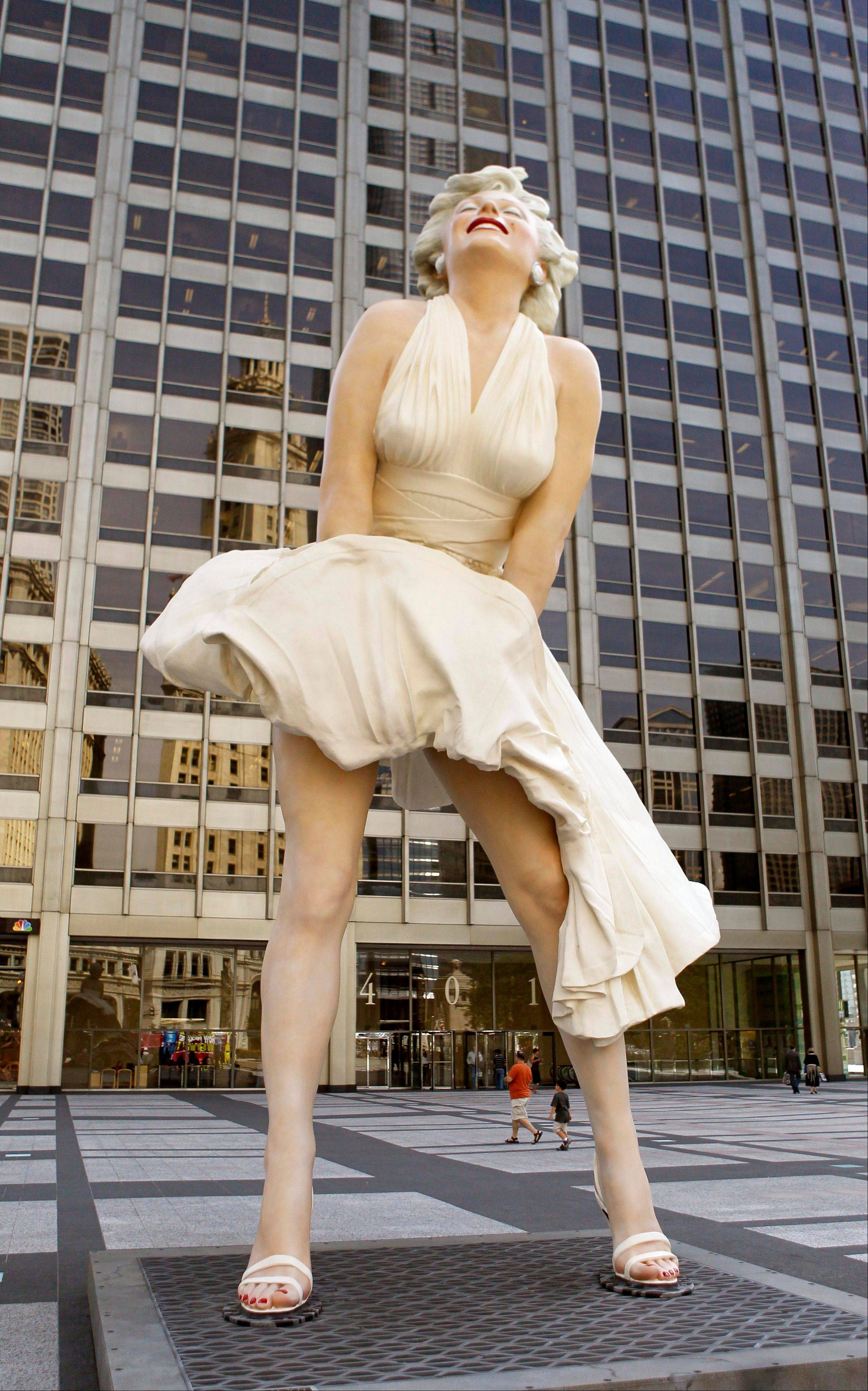 Seward Johnson's 26-foot-tall sculpture of Marilyn Monroe, in her most famous windblown pose, stands on Michigan Ave. Friday, July 15, 2011 in Chicago.