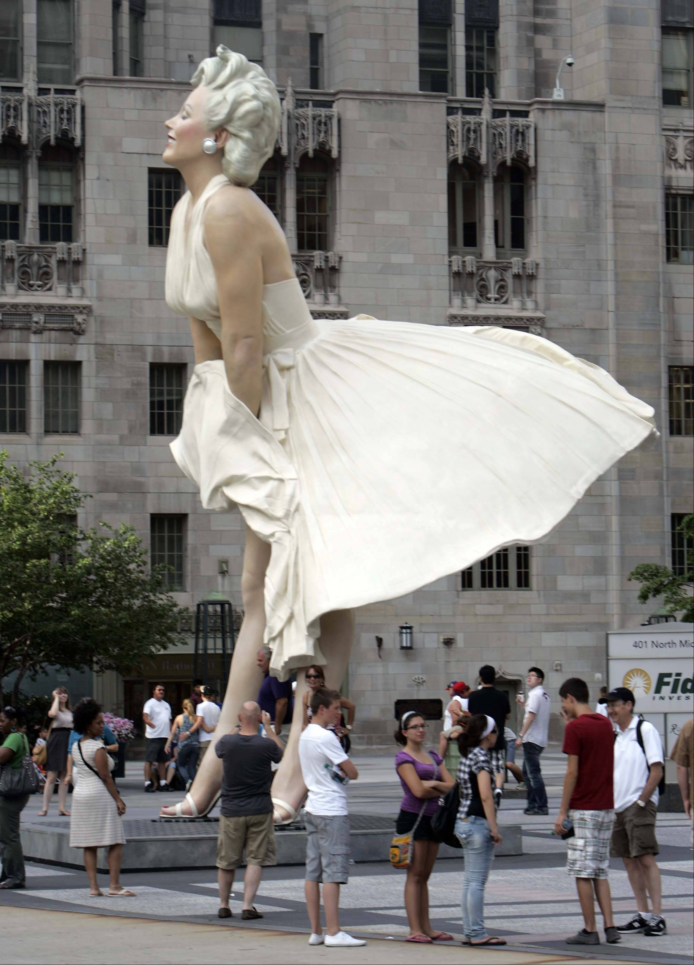 """Forever Marilyn"" was unveiled Friday and stands in Pioneer Court near the Michigan Avenue Bridge in Chicago."