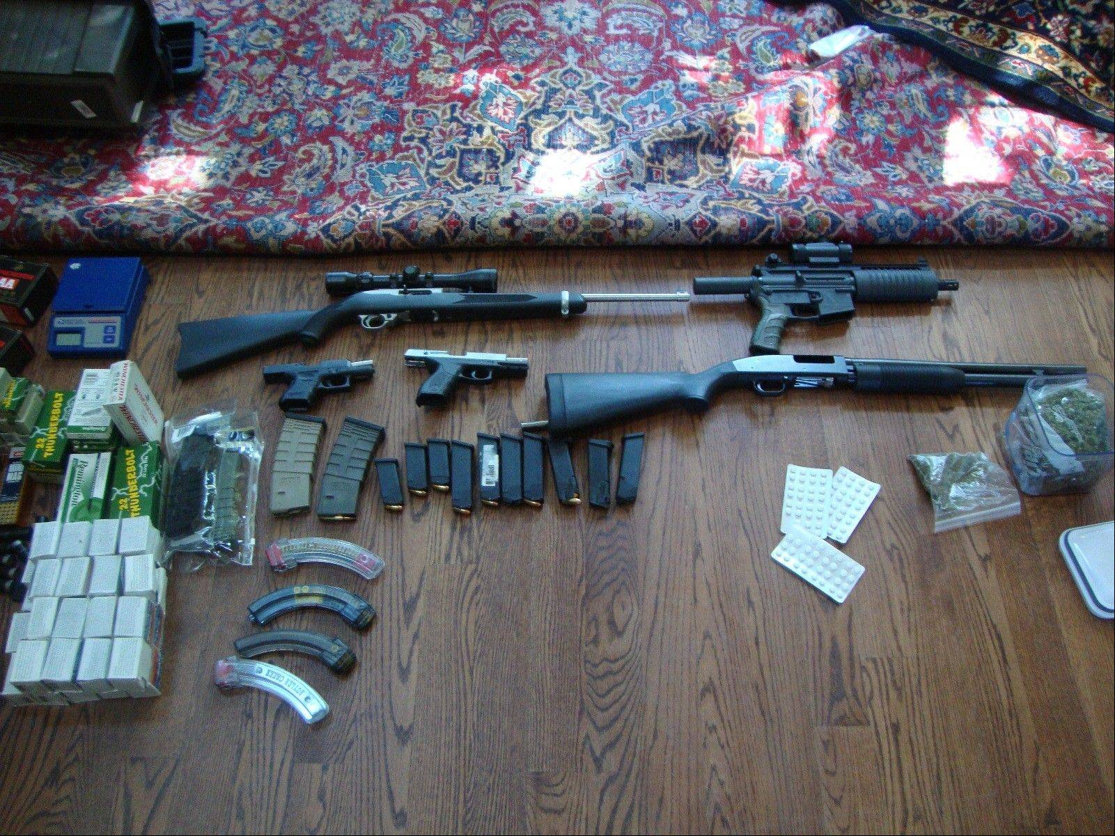Cook County sheriff's police found these weapons inside a house in Glenview where marijuana was being grown.