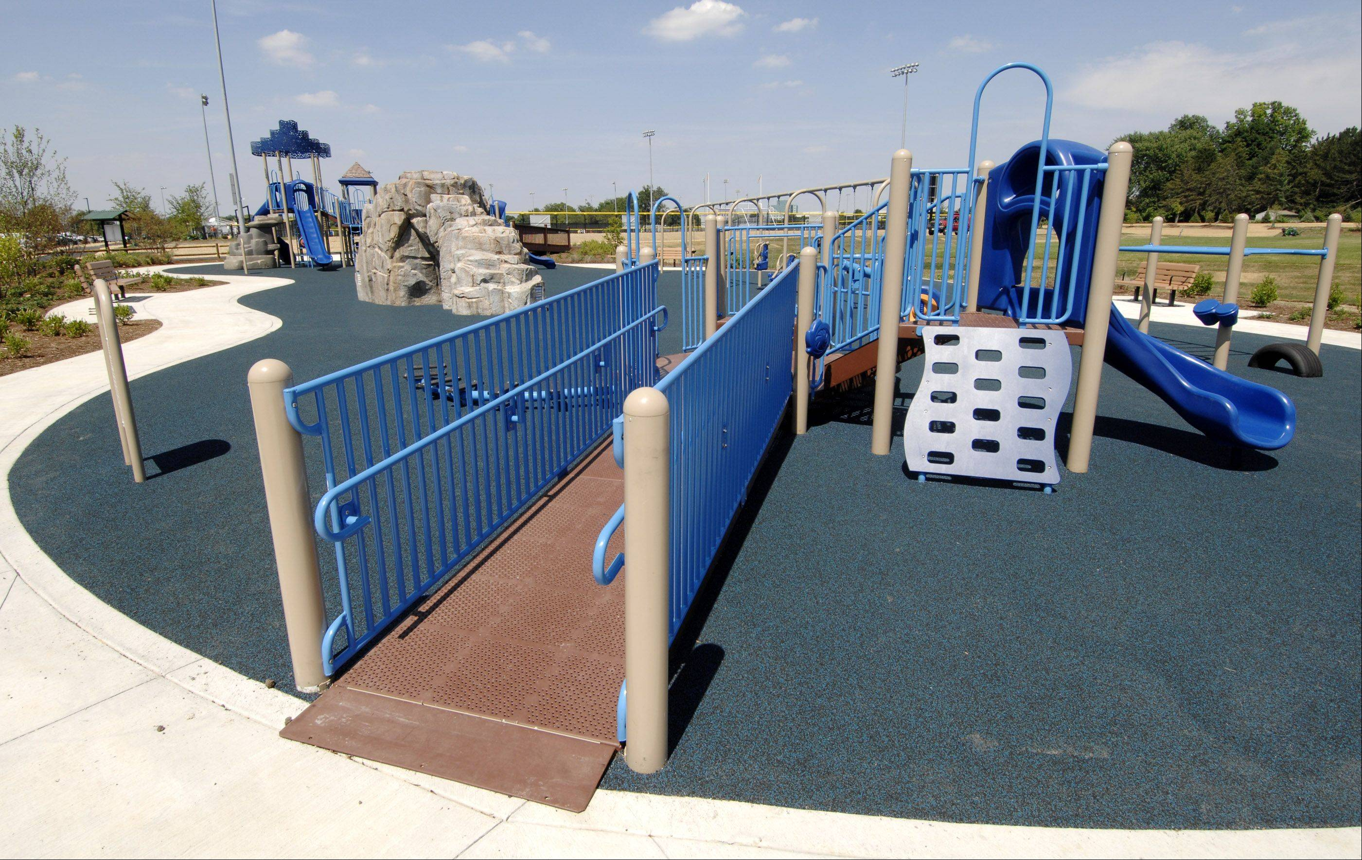 The new children's playground area has a rubbery surface and ramps for accessibility at the newly refurbished Nike Sports Complex on Mill Street just south of Diehl Road in Naperville.