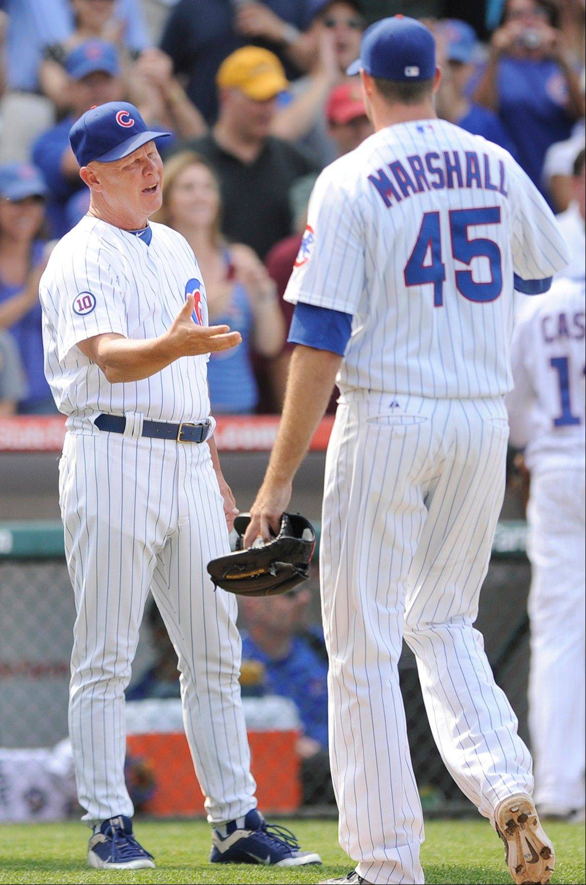Cubs manager Mike Quade congratulates Sean Marshall after he got the final out in relief of Carlos Marmol in a 2-1 victory over the Florida Marlins.