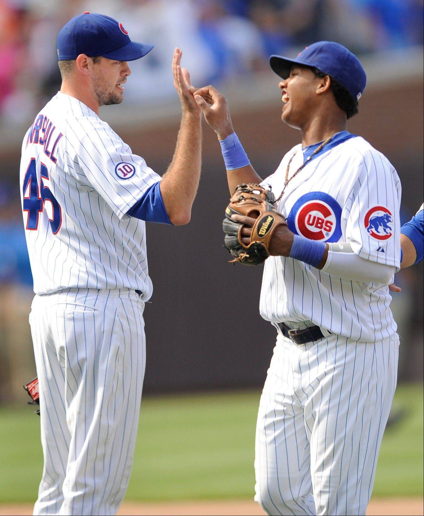 Sean Marshall, left, celebrates with Starlin Castro after picking up a save against the Florida Marlins at Wrigley Field.