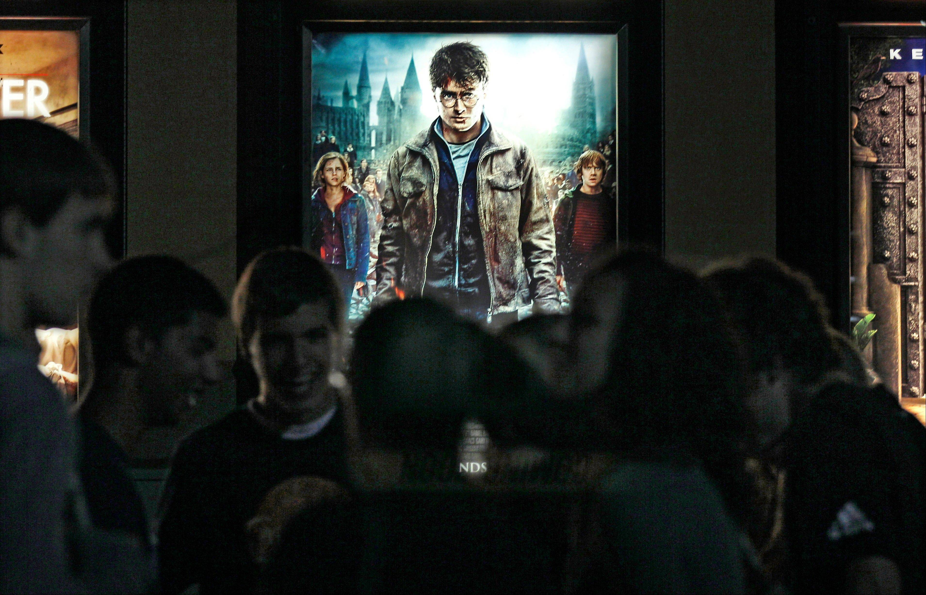 "Moviegoers wait for the midnight showing of ""Harry Potter and the Deathly Hallows Part II"" in Merrimack, N.H.."