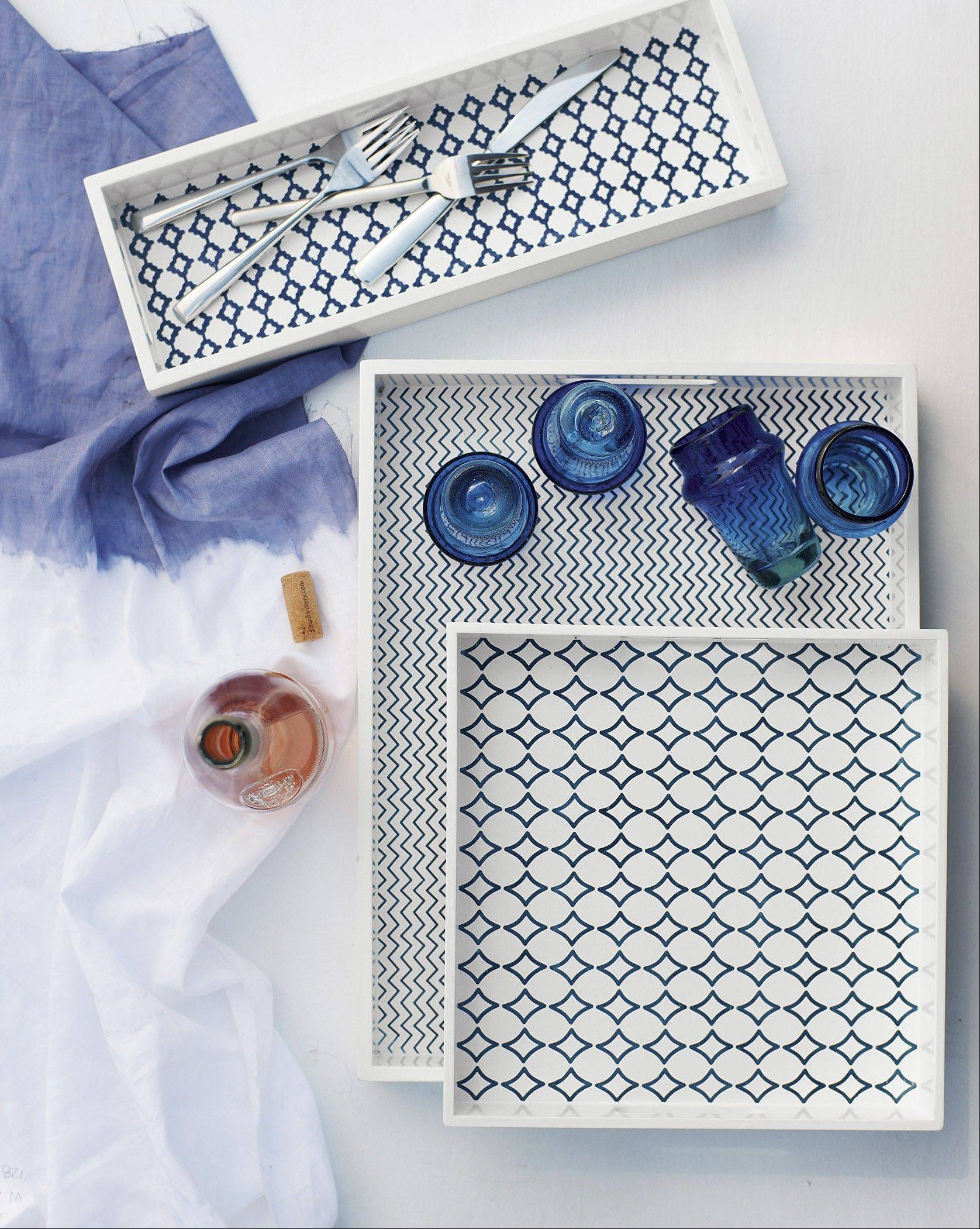 This product image courtesy of West Elm shows Mediterranean tilework-patterned lacquered trays from David Stark's collection. In his summer collection for West Elm, Stark has returned to his roots as a painter.