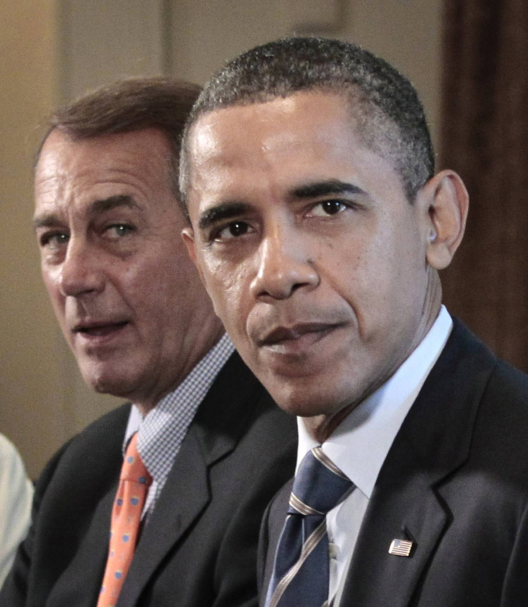 Racing the debt clock, Congress is working on dual tracks while President Barack Obama, shown here with Ohio Republican John Boehner, appeals to the public in hopes of influencing a deal that talks have failed to produce so far.