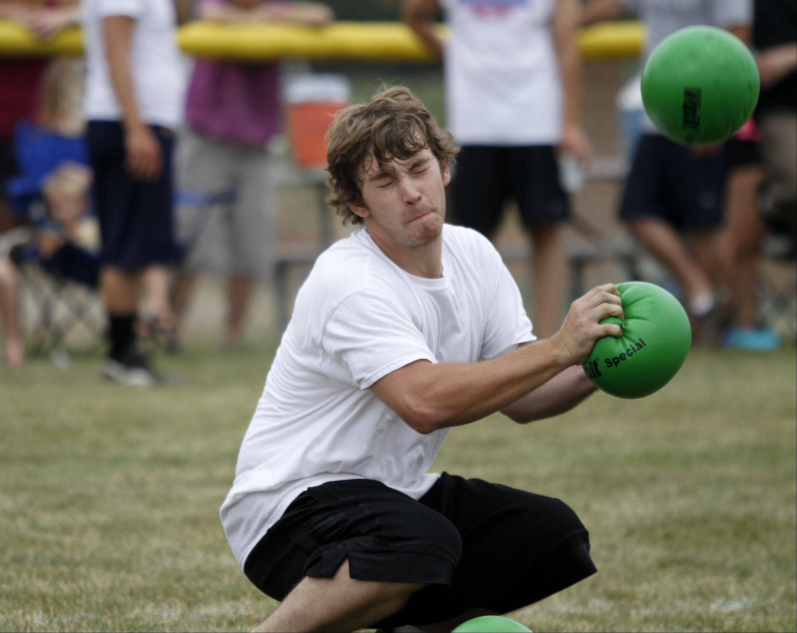 Dan Groves, from St. Charles, deflects a ball.