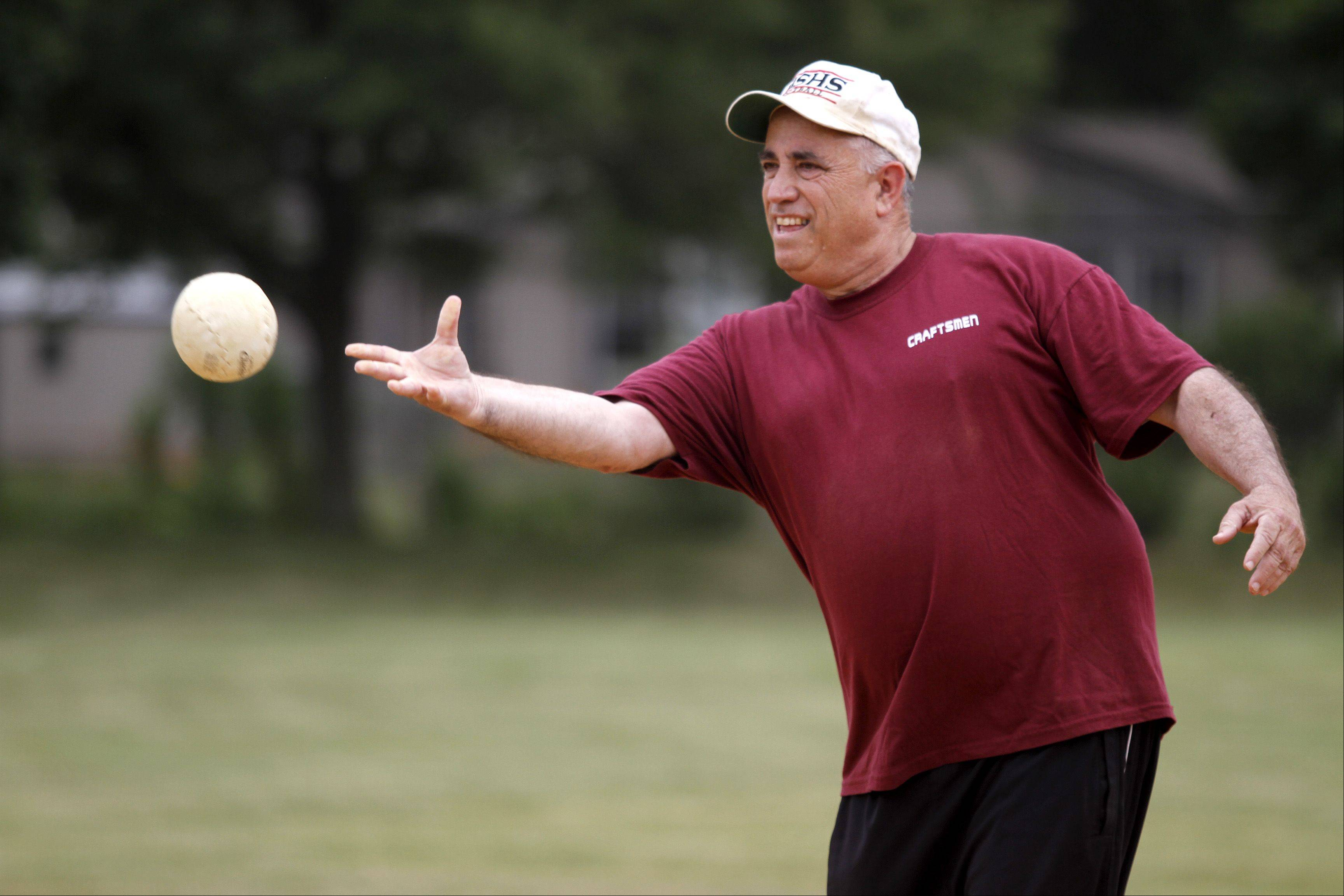 Charlie Lowy, from Arlington Heights, throws a pitch during the annual Terry Moran Softball Tournament Saturday morning in Rolling Meadows.