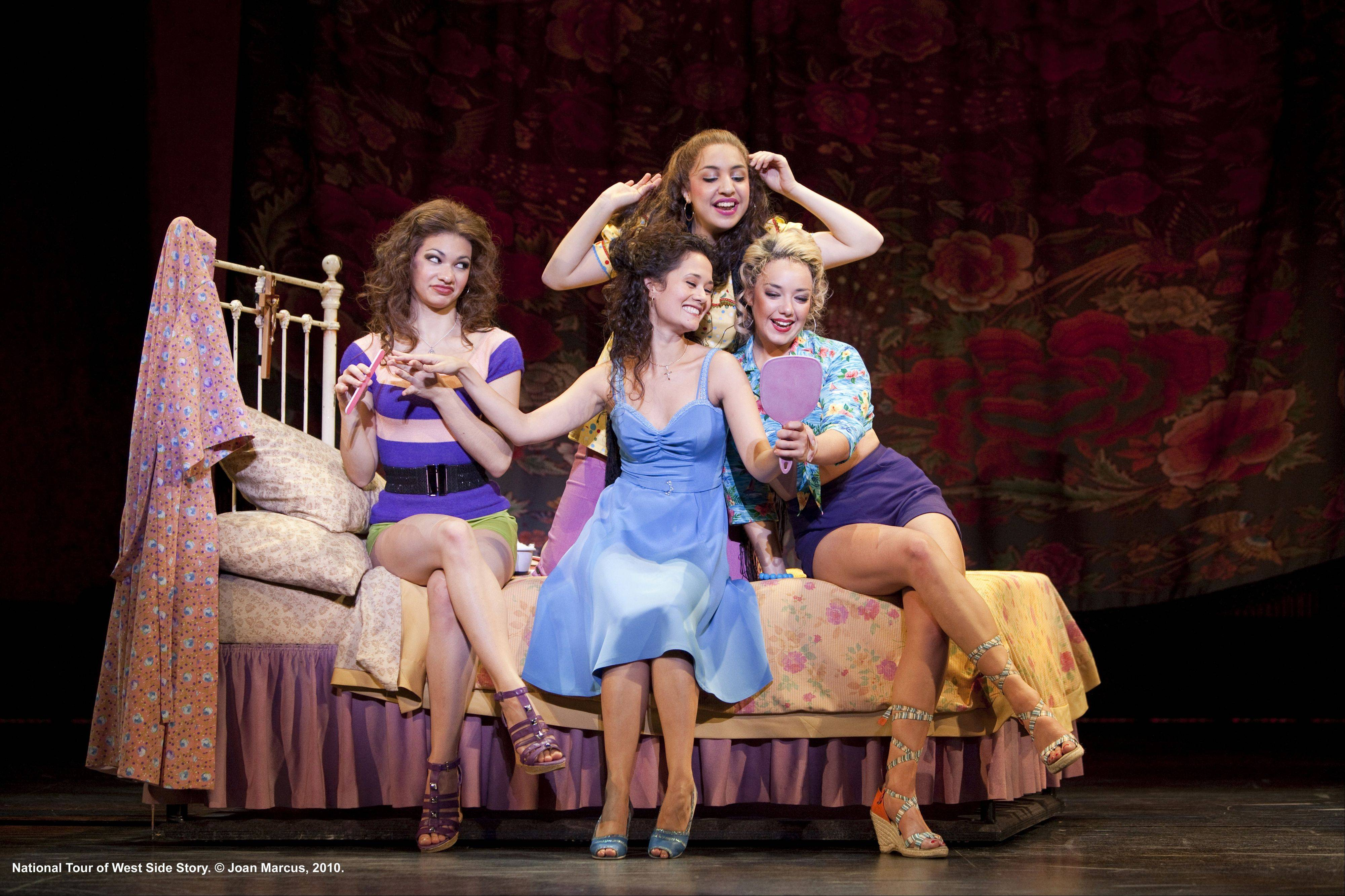 "Maria (Park Ridge native Ali Ewoldt, in blue) sings ""I Feel Pretty"" to her friends (Kathryn Lin Terza, Dea Julien and Lori Ann Ferreri) in ""West Side Story."" The new national tour plays the Cadillac Palace Theatre in Chicago from July 19 through Aug. 14."