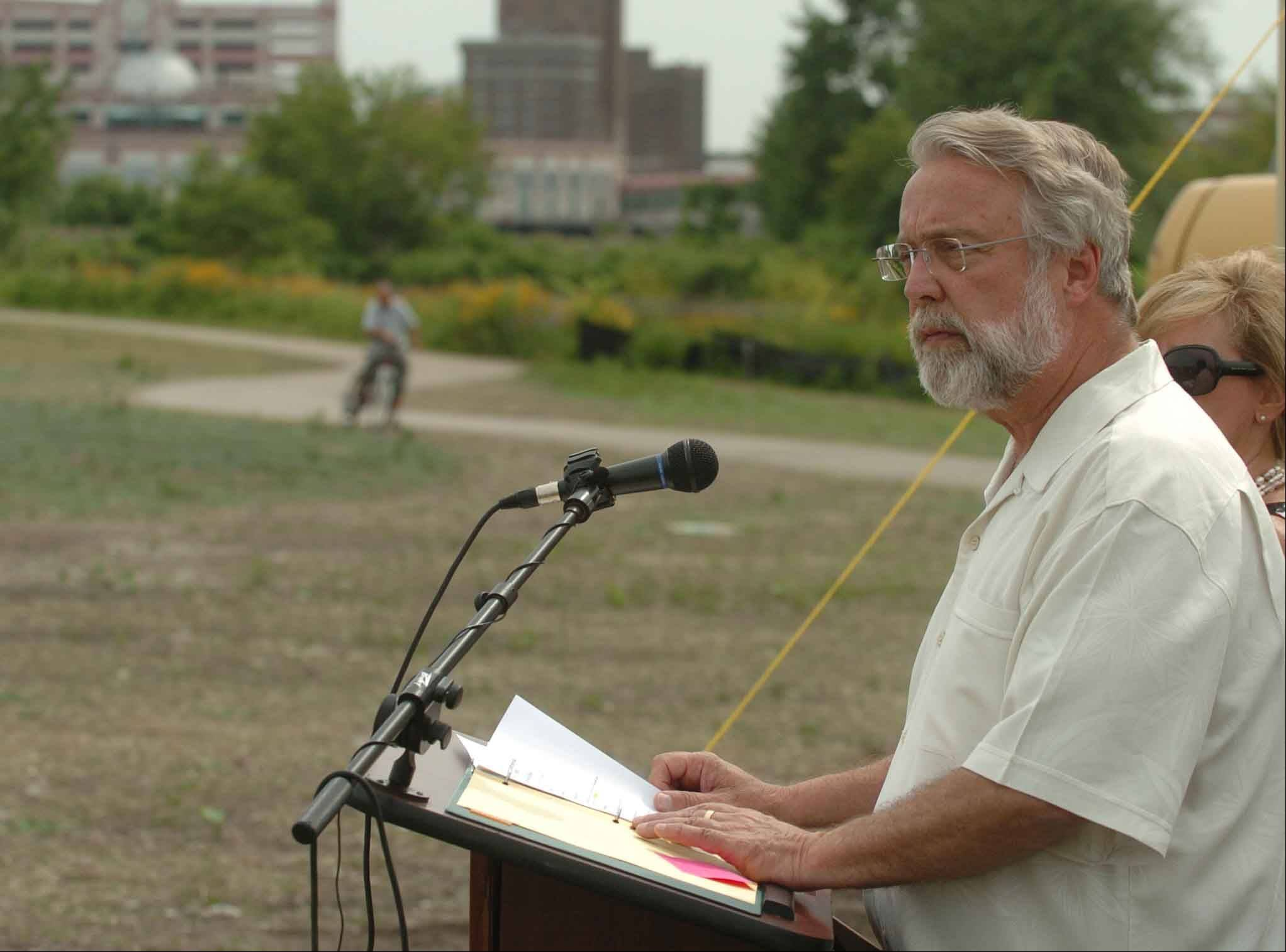 Aurora Mayor Tom Weisner speaks Friday at the future site of RiverEdge Park. Construction is set to begin by July 20.