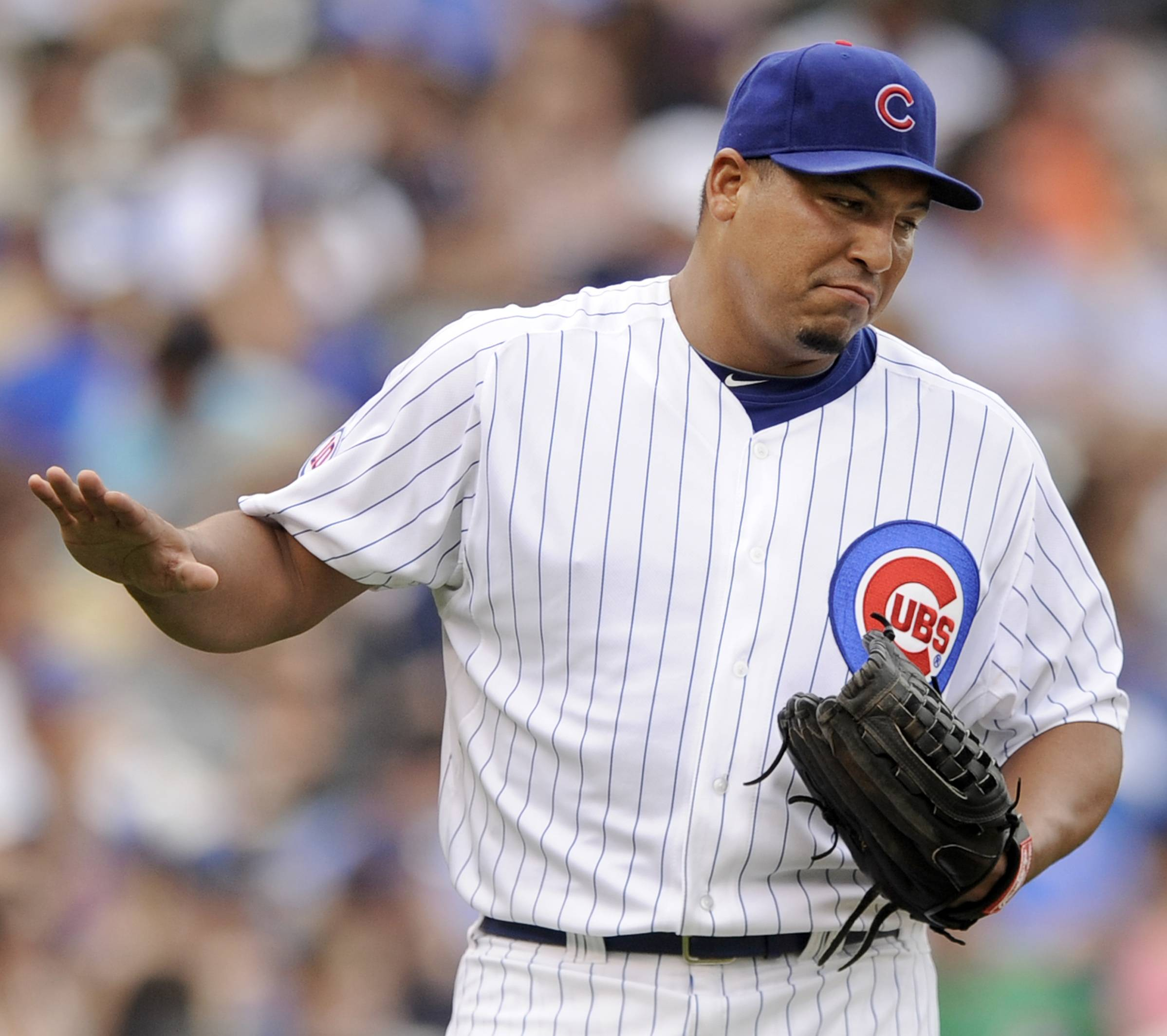 Carlos Zambrano reacts after giving up a solo home run to Florida Marlins' Mike Stanton during the fourth inning Saturday at Wrigley Field.