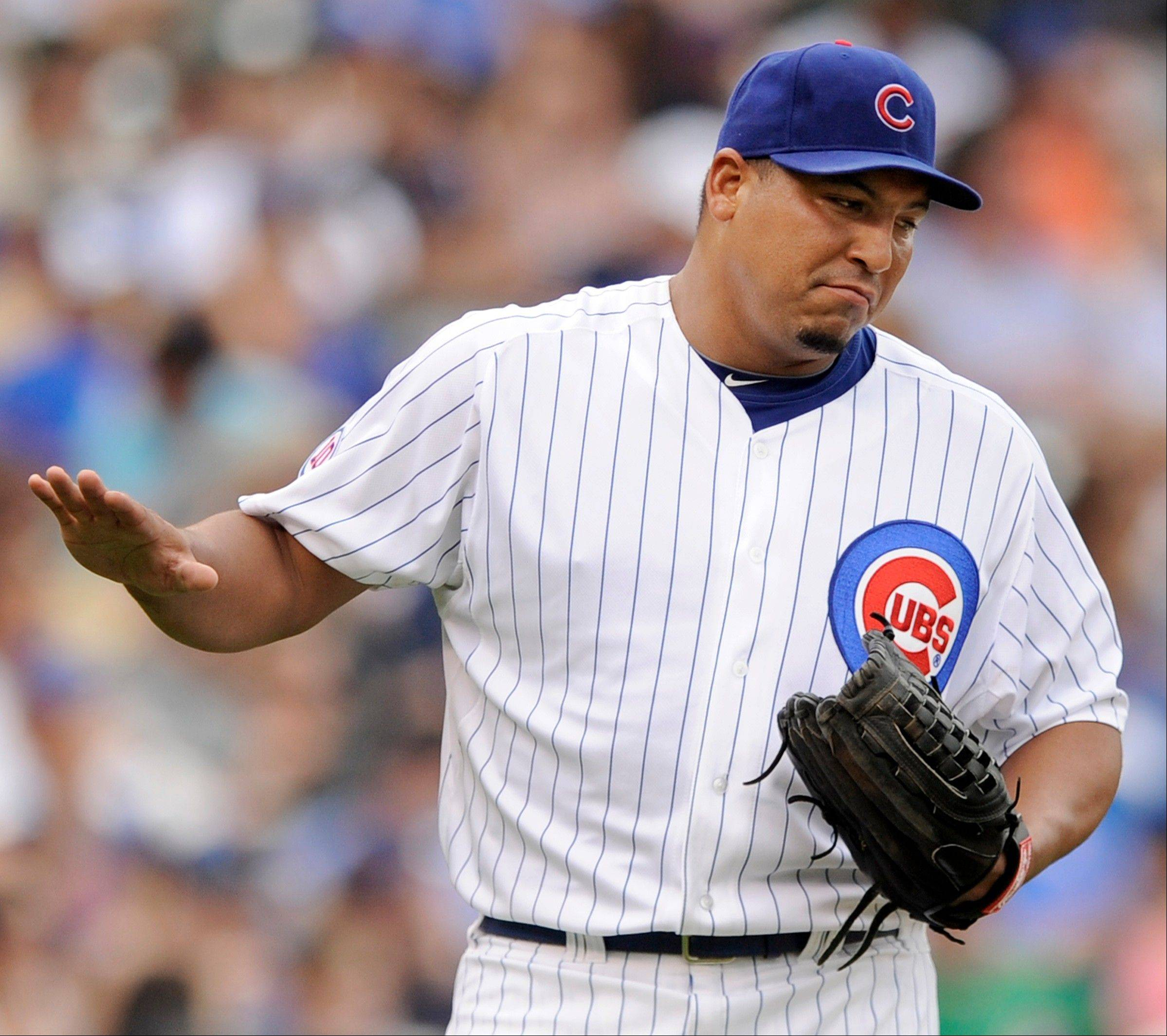 Carlos Zambrano reacts after giving up a solo home run to the Florida Marlins' Mike Stanton during the fourth inning Saturday at Wrigley Field. The Cubs lost 13-3.