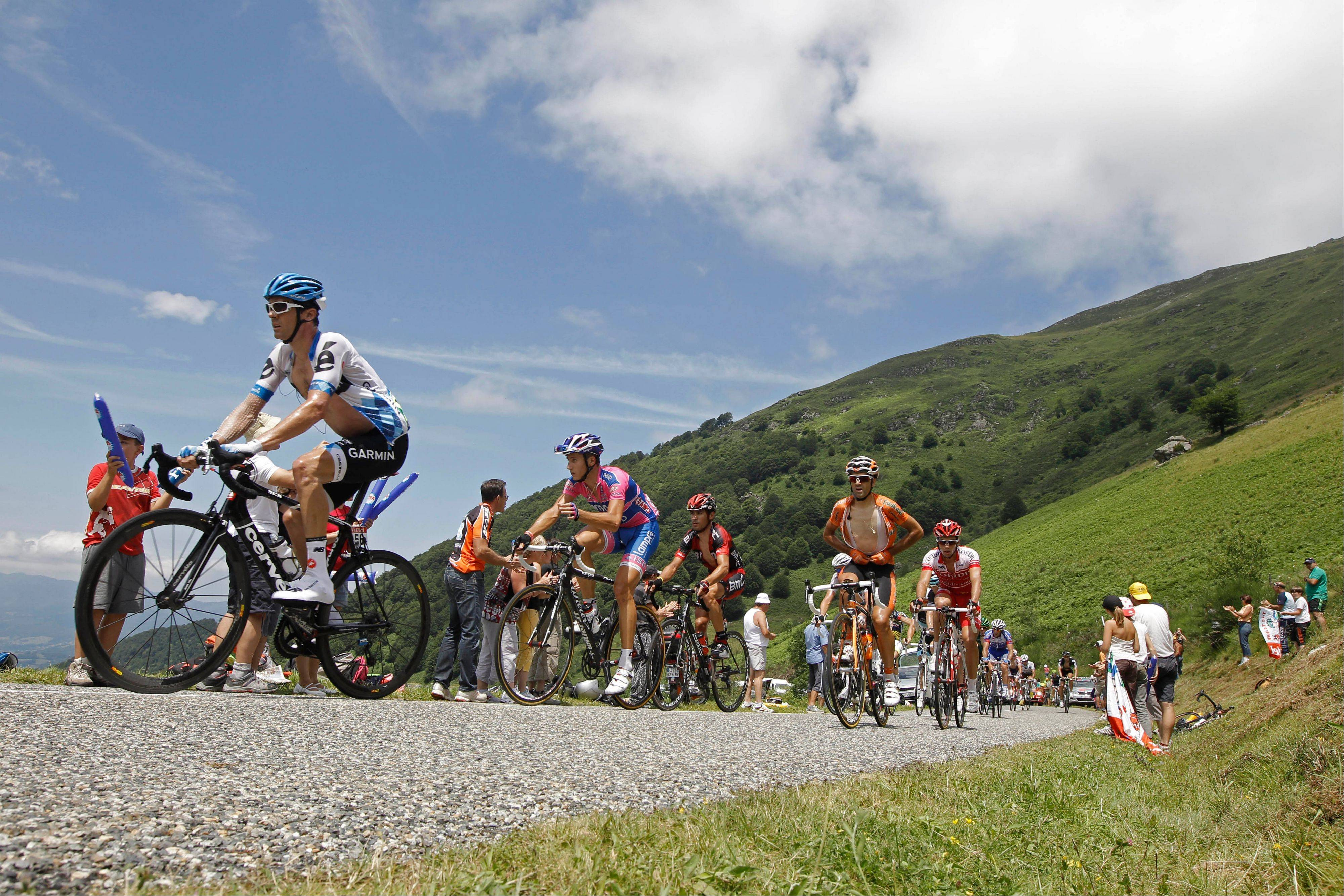 David Millar of Britain, left, and Adriano Malori of Italy, in second position, ride in the breakaway group as they climb Col de la Core pass during the 14th stage of the Tour de France Saturday.