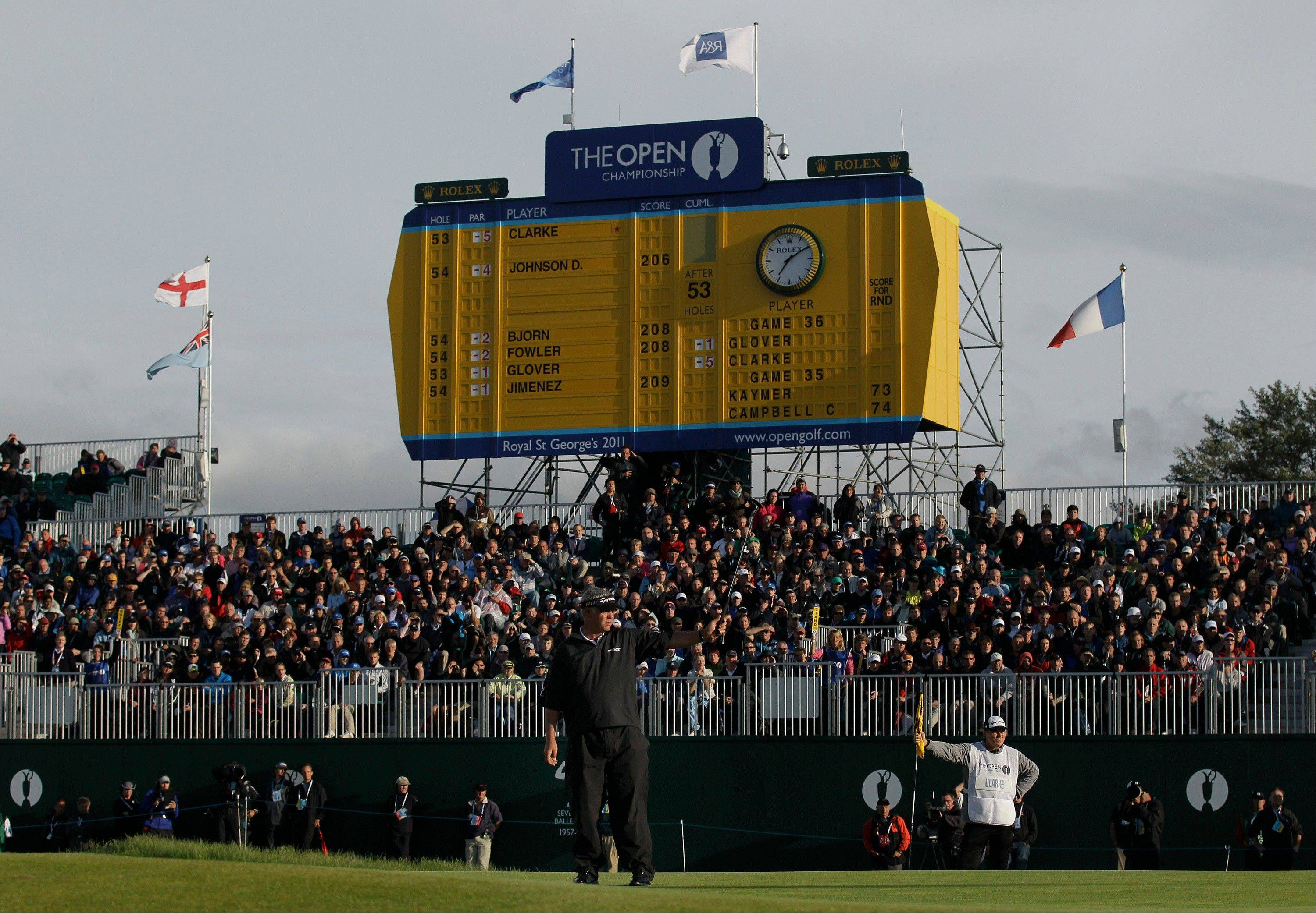 Northern Ireland's Darren Clarke reacts in front of the scoreboard on the 18th green after his round during the third day of the British Open Golf Championship at Royal St George's golf course Sandwich, England, Saturday, July 16, 2011. (AP Photo/Matt Dunham)