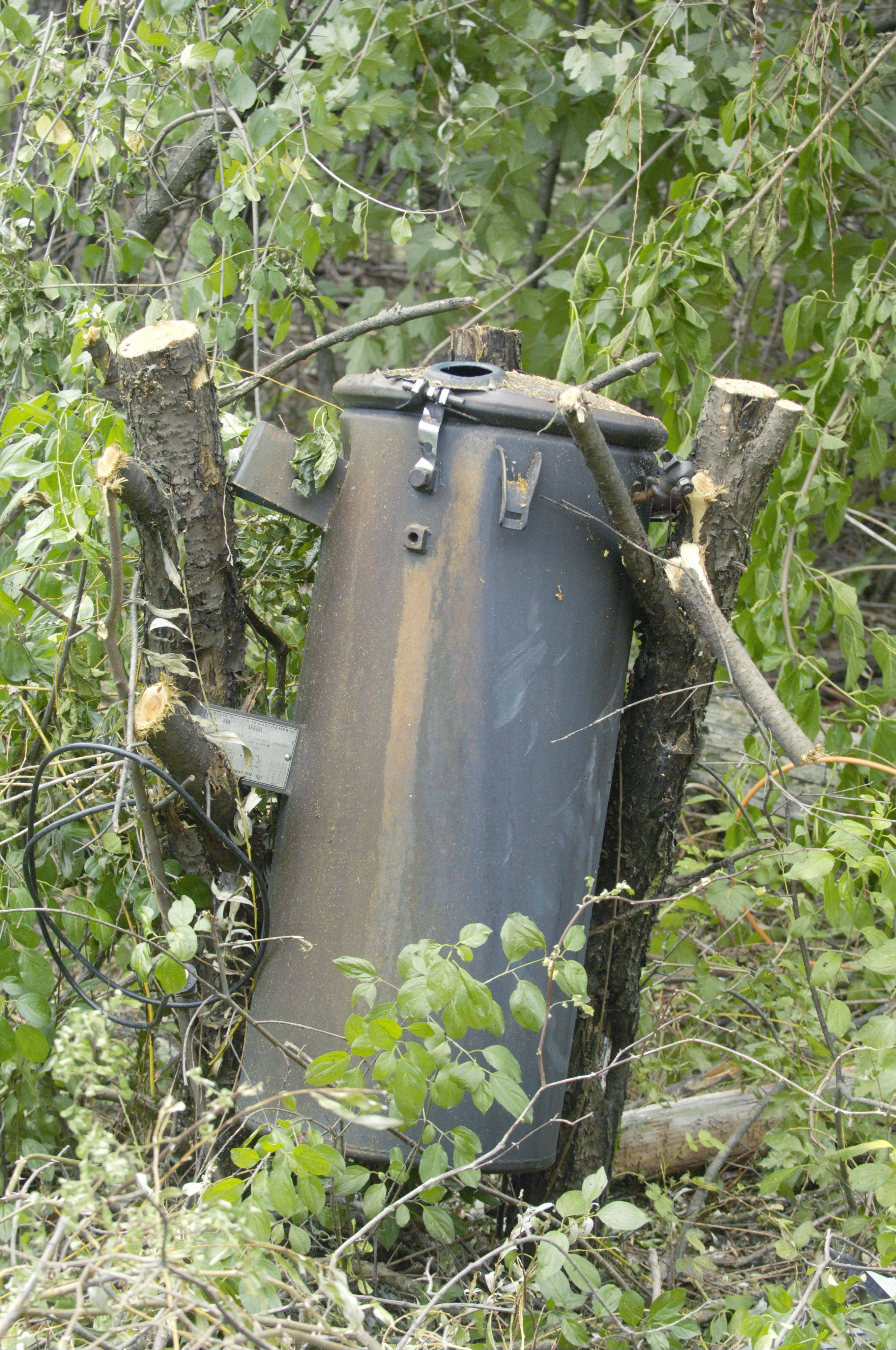 A blackened transformer, which was replaced Saturday, rests on the ground near Barrington.