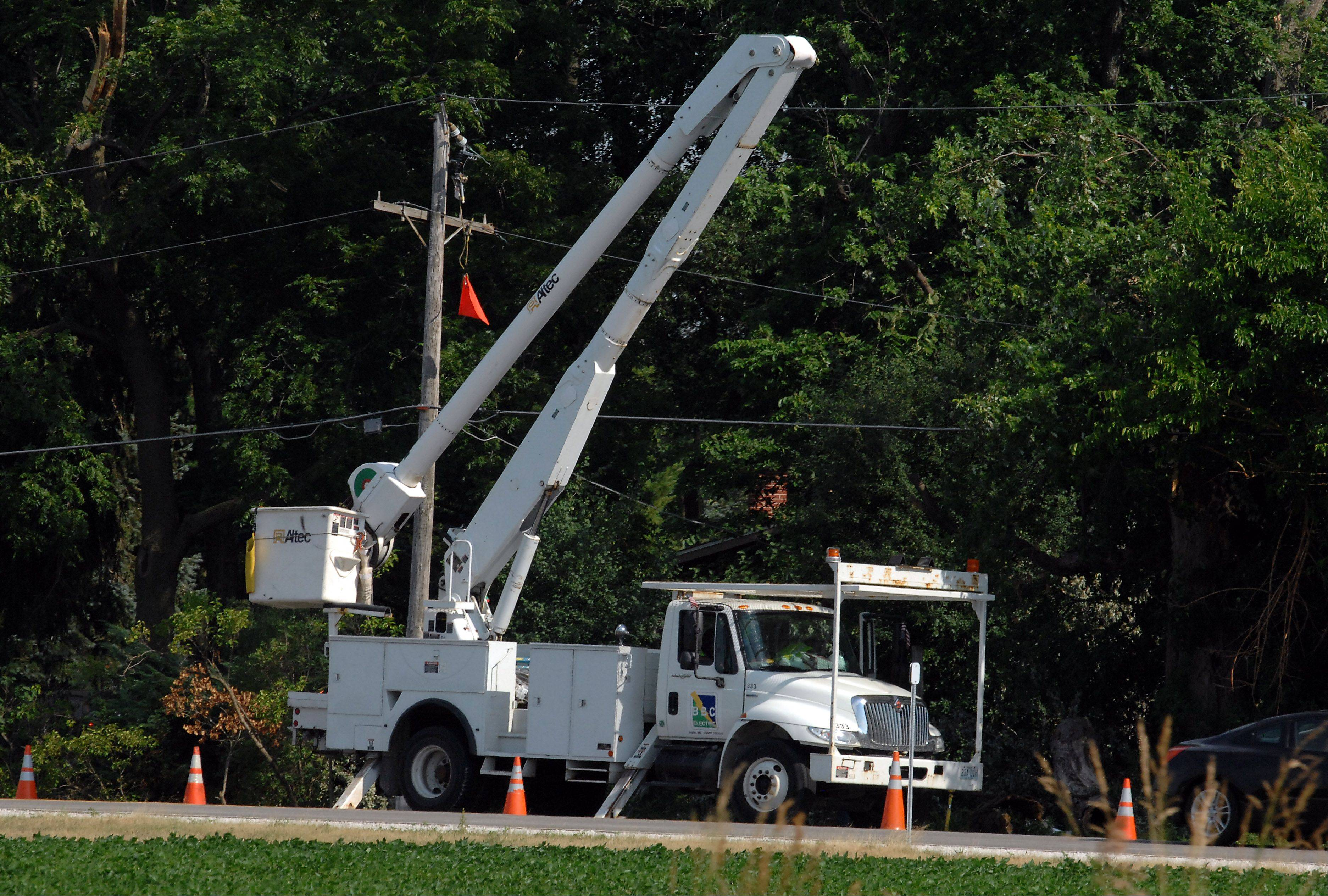 Utility trucks dot the Lake County countryside Saturday, as they wrap up getting power back online.